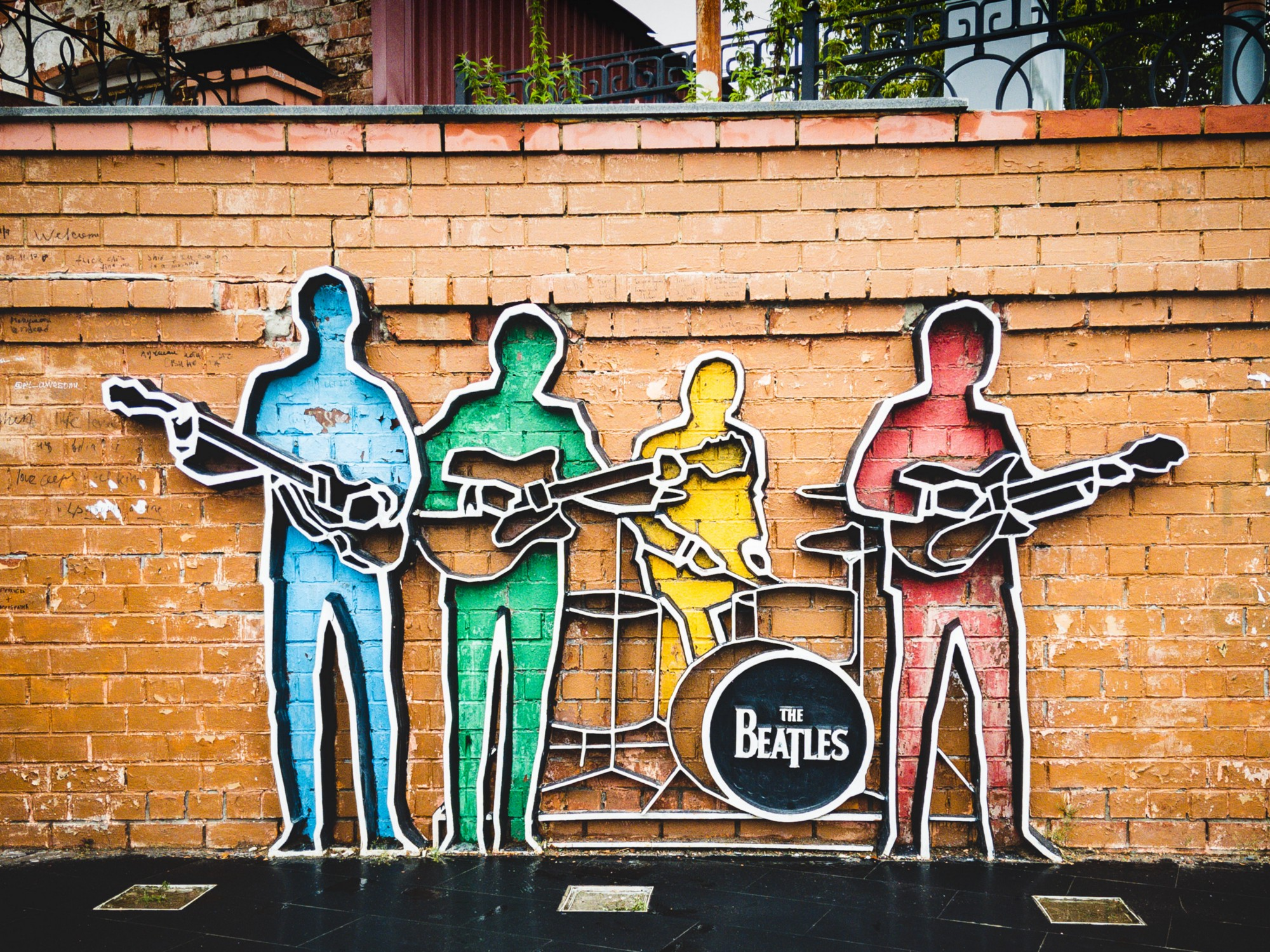 An image of colorful silhouettes of The Beatles.