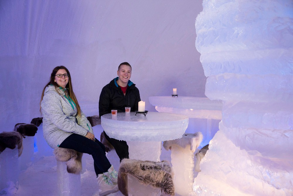 Couple enjoying Arctic Snow Hotel, Finland