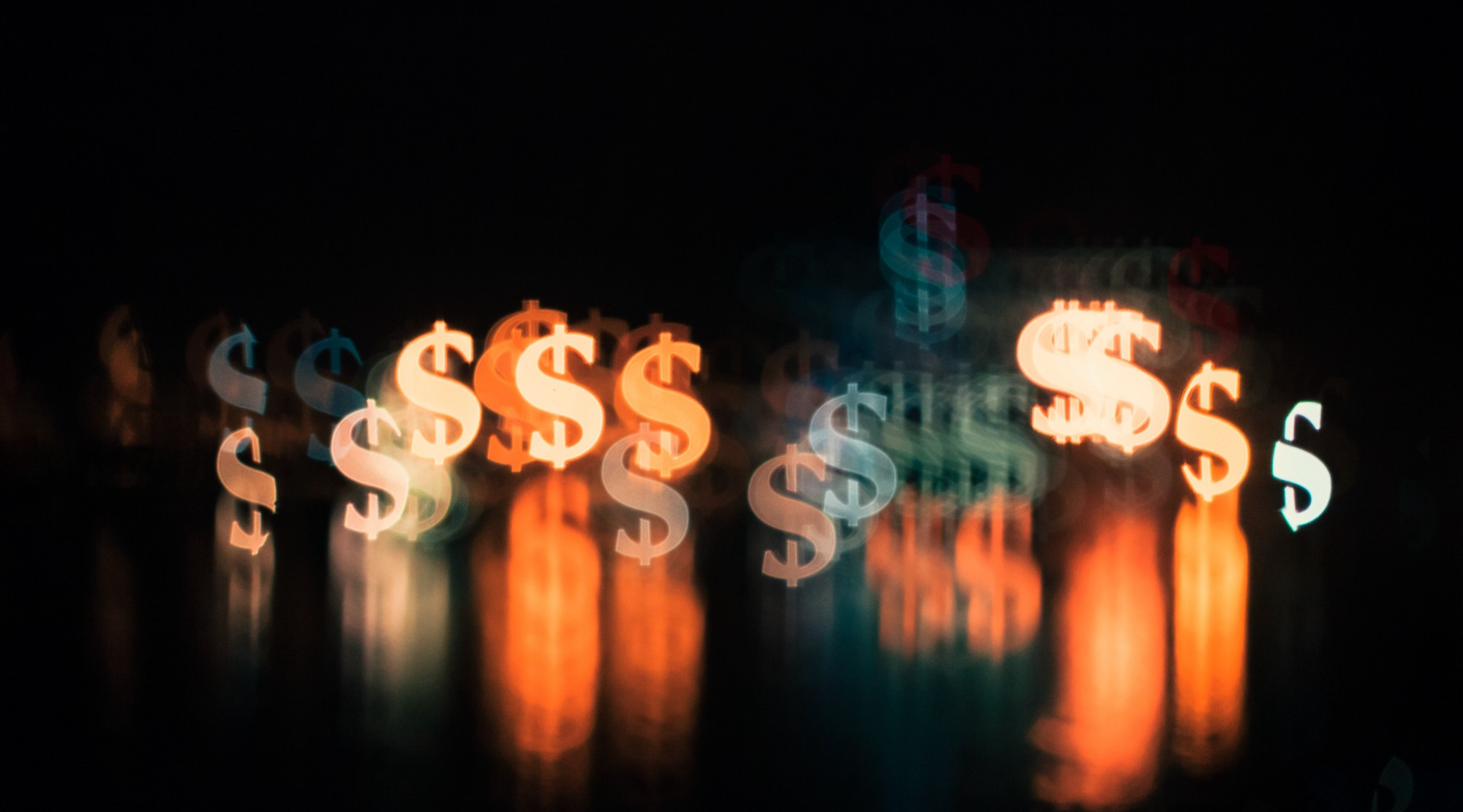 Fuzzed out image of many dollar signs