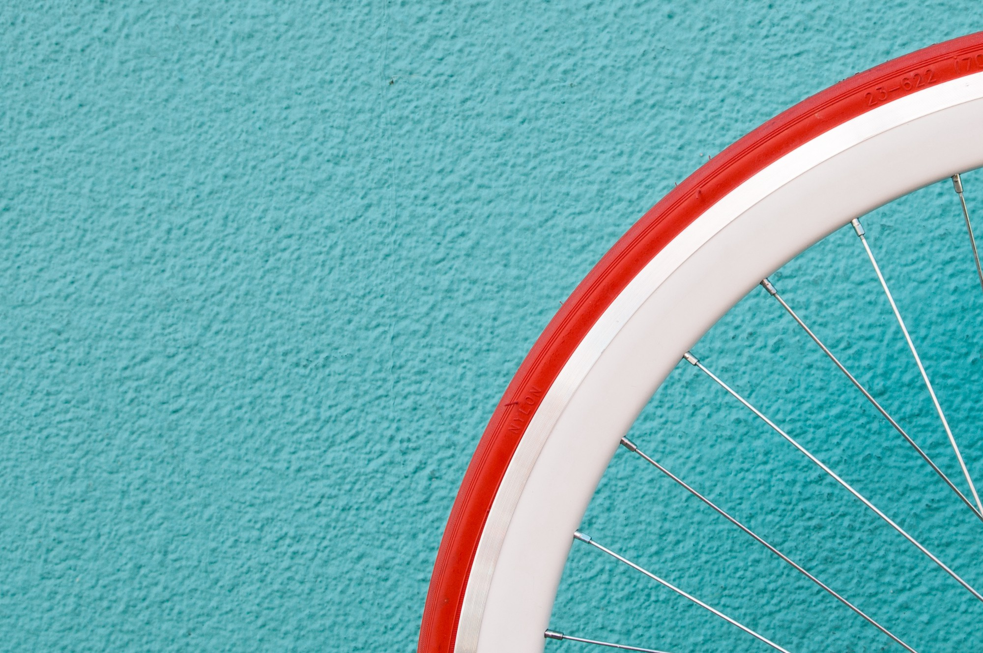 photo of red bicycle wheel