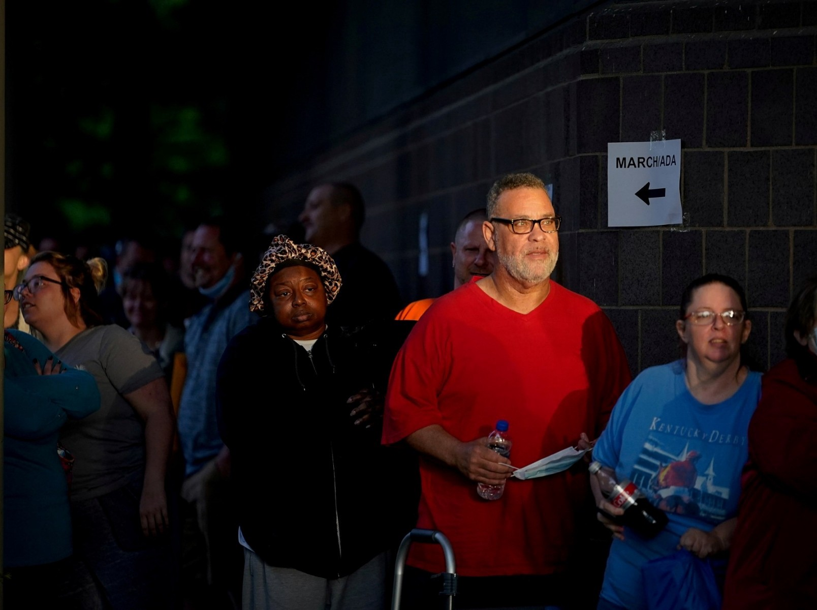 People line up outside the Kentucky Career Center before opening to find assistance with their unemployment claims in Frankfort, Kentucky, June 18, 2020. Photo by Bryan Woolston/Reuters