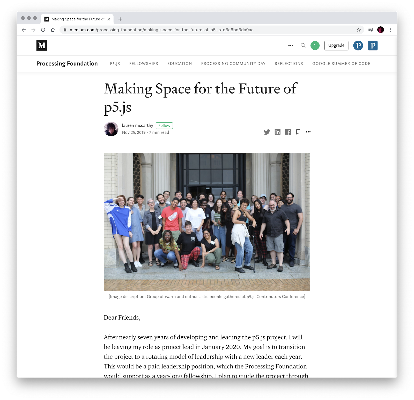 Screenshot of the medium article, with a group photo of at least two dozen people smiling for the camera.