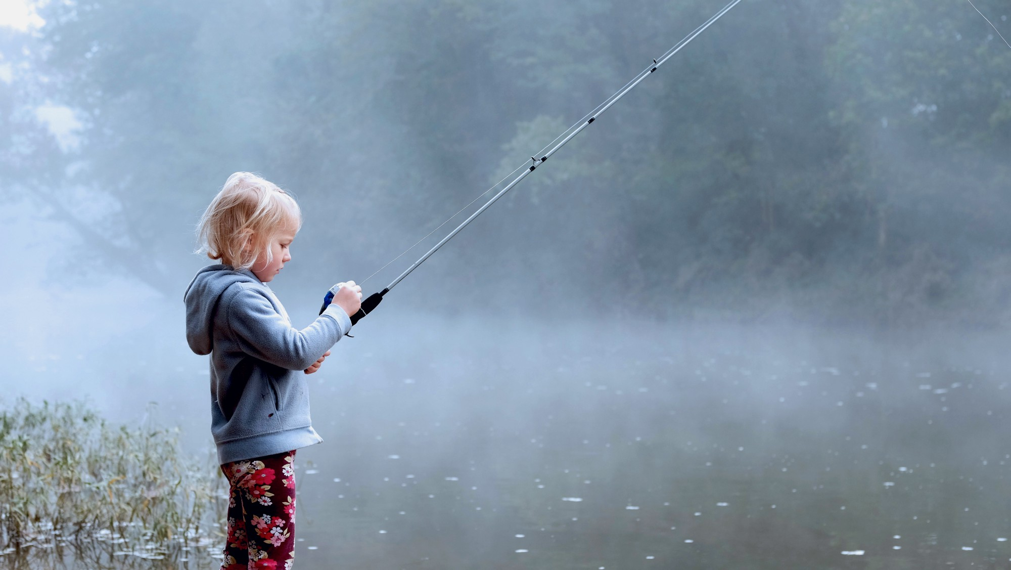 A young child fishing