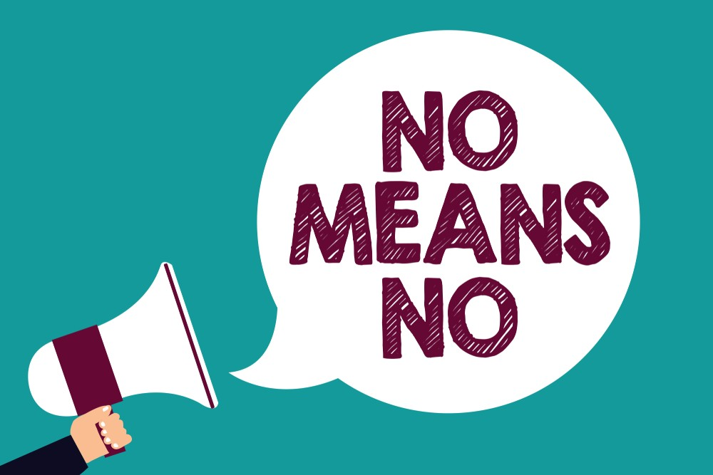 Text sign showing No Means No. Conceptual photo Stop abuse gender violence Negative response Sexual harassment Man holding megaphone loudspeaker speech bubble screaming green background. Consent concept