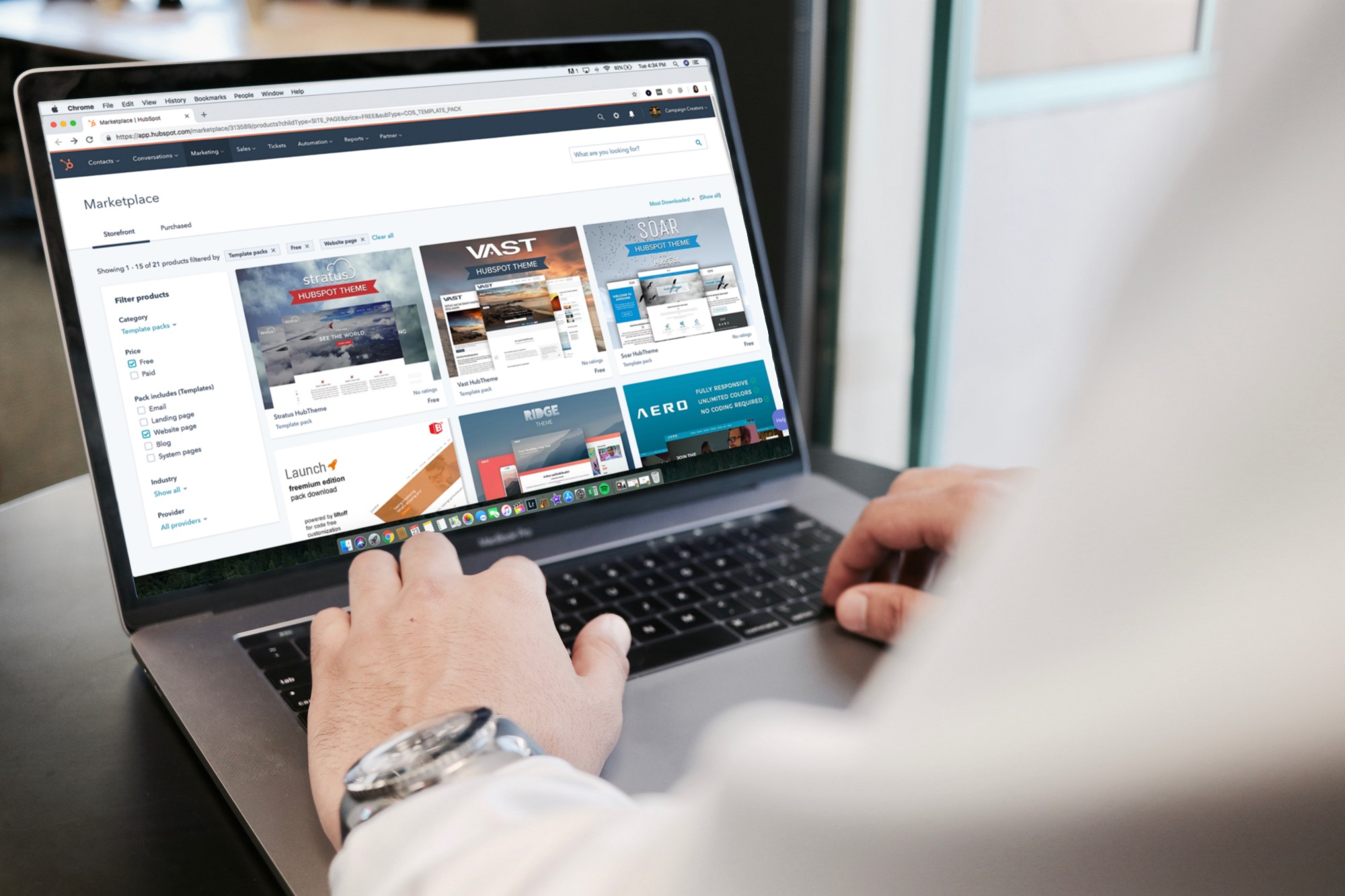 A man shops on an online marketplace for website themes
