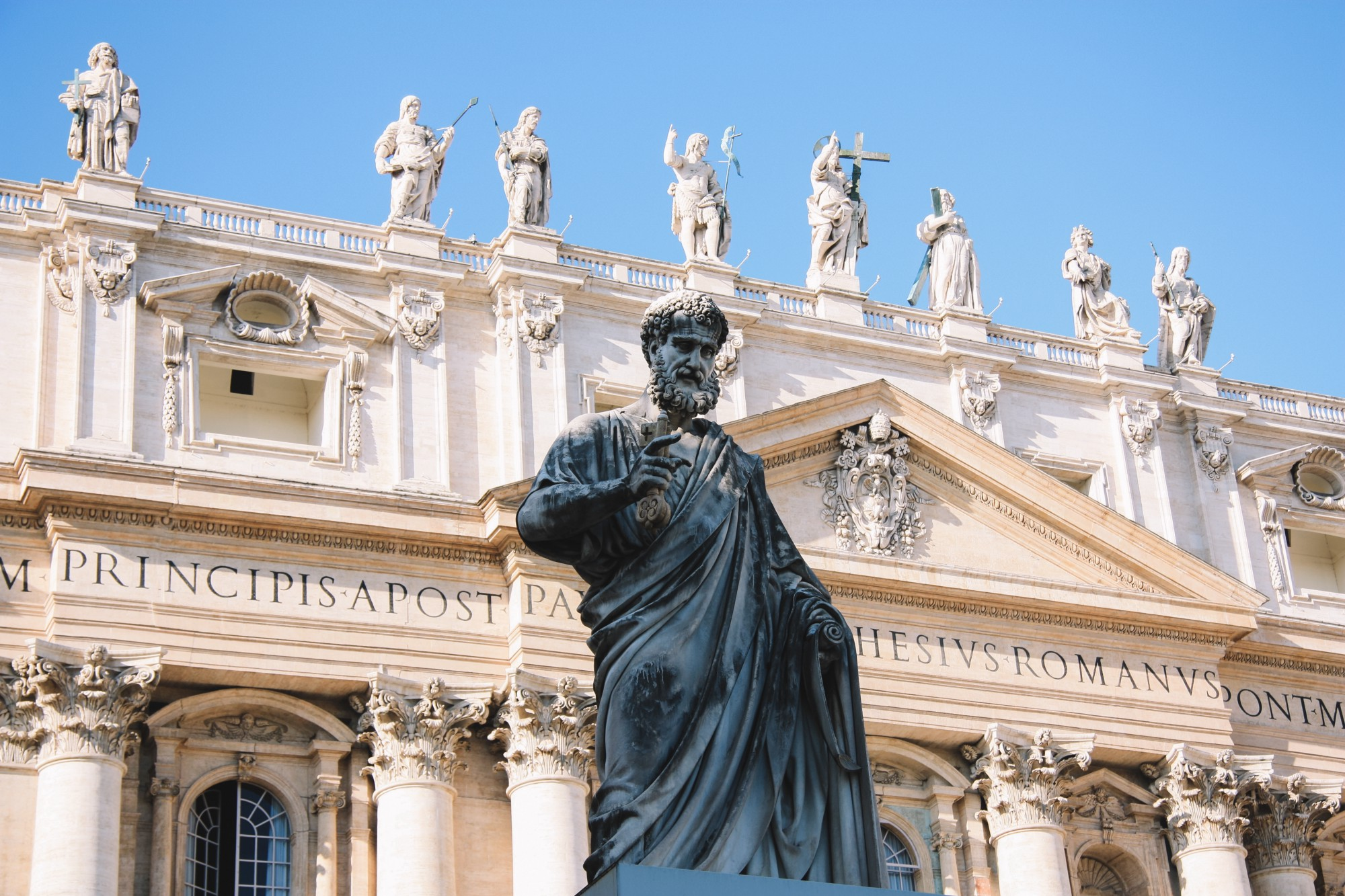 A statue in front of St. Peter's Basilica in the Vatican