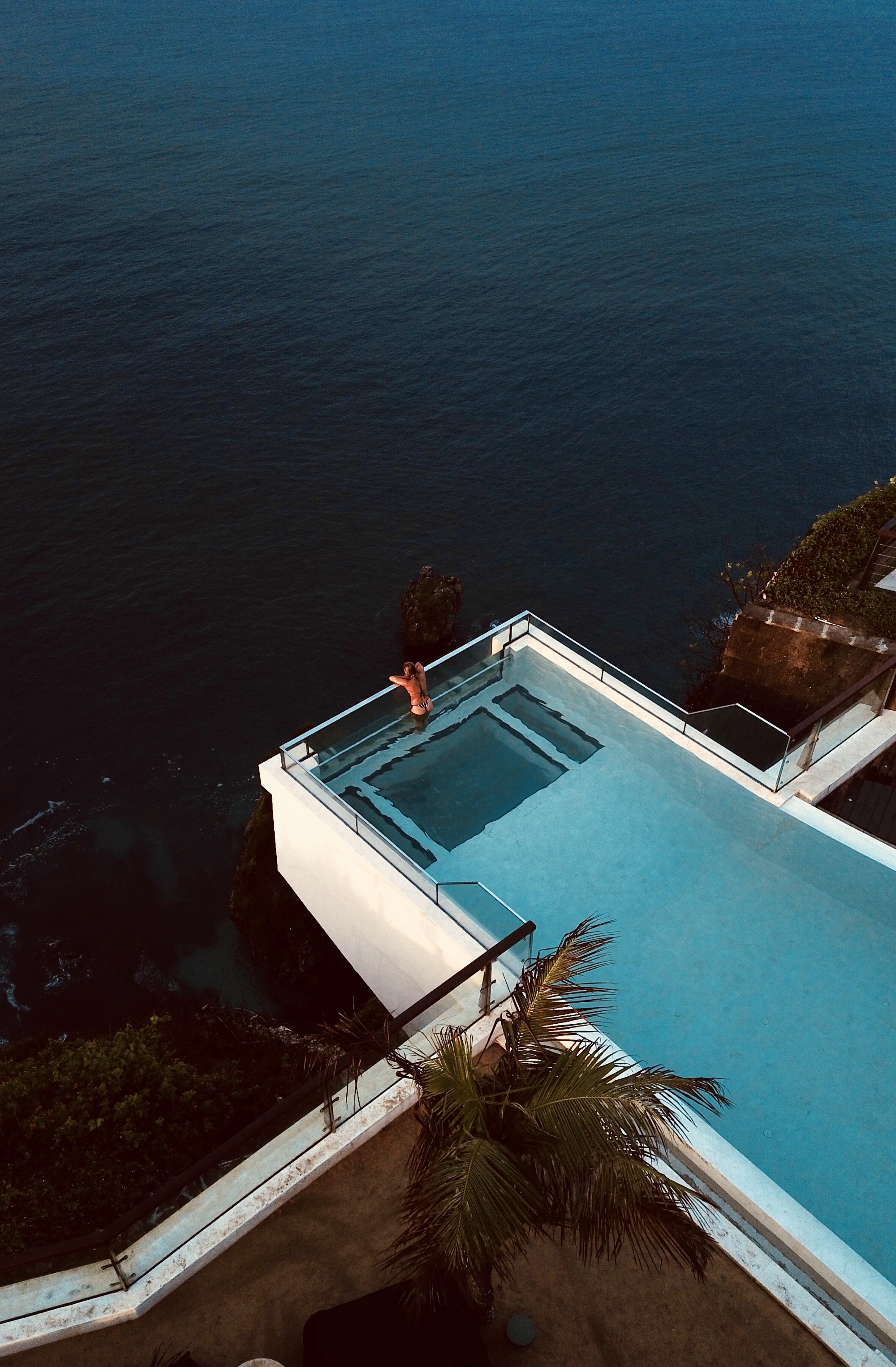 woman in a swimming pool beside the sea