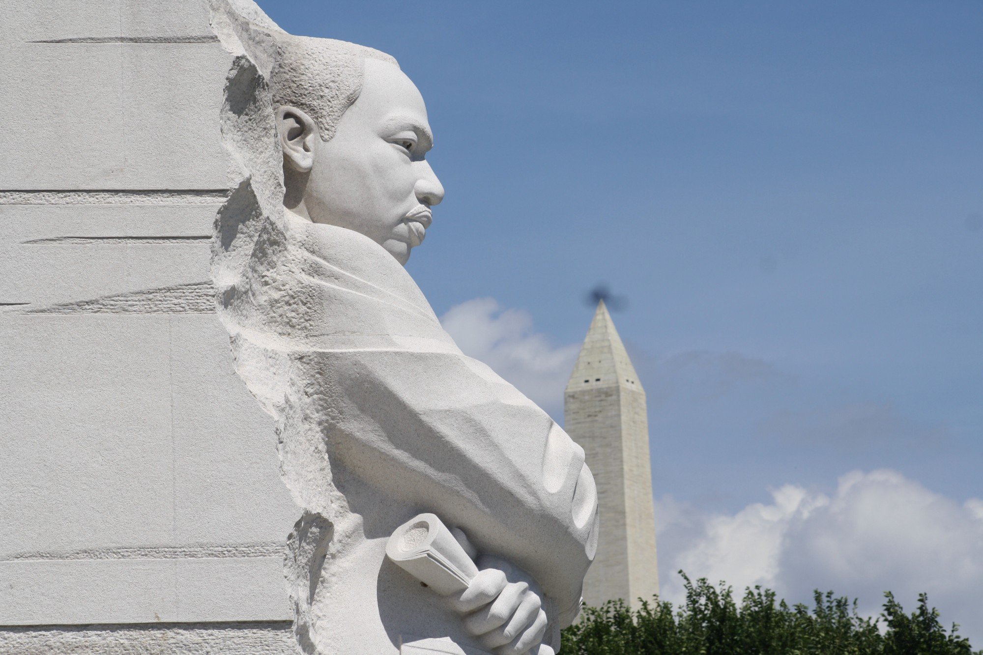 Sculpture of Martin Luther King, Jr. with Washington National Monument in the background—Black History Month