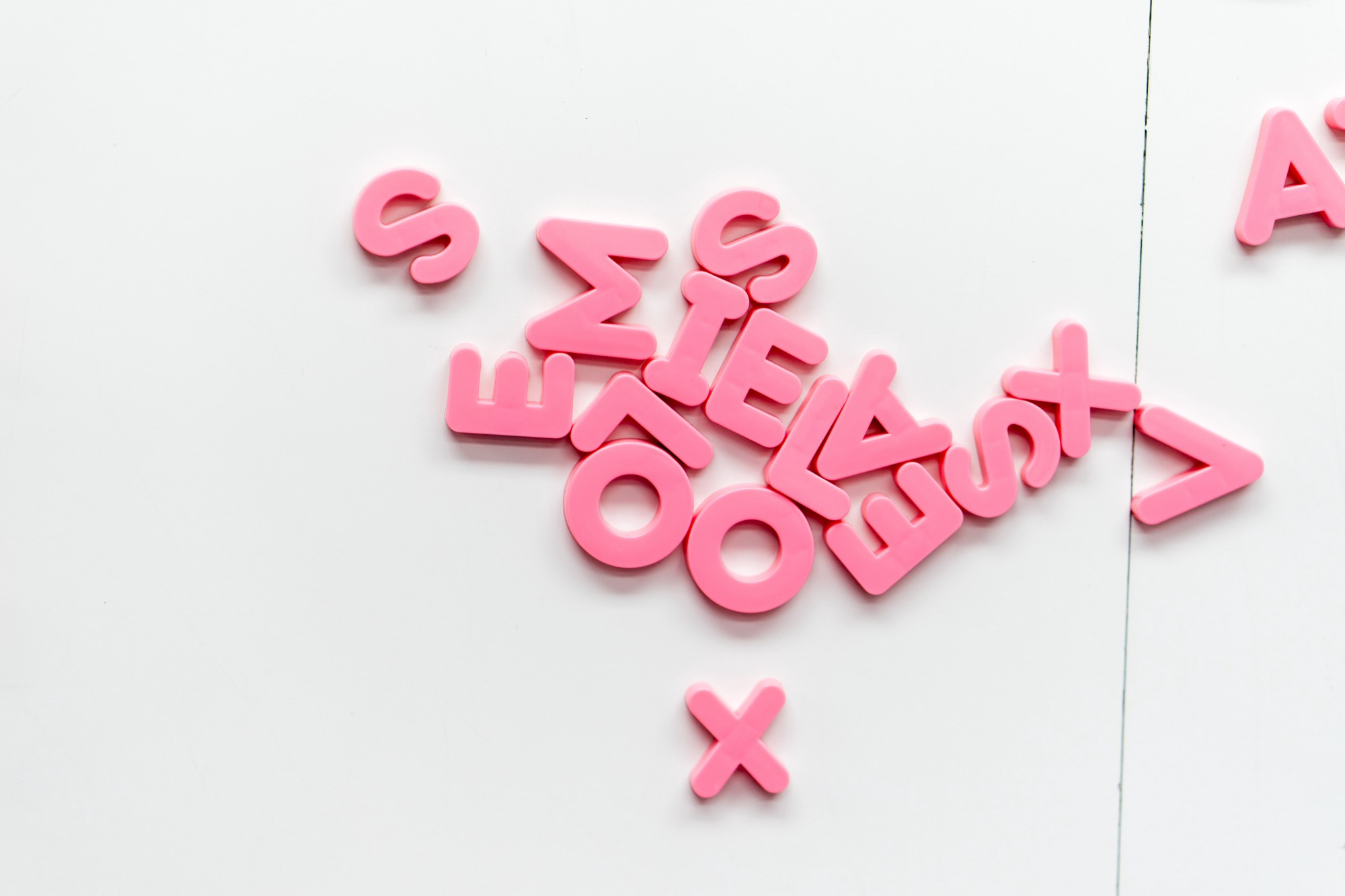3D letters of Latin alphabet in pink are on a white background