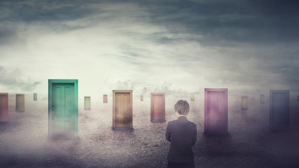 Businesswoman in front of many different doors choosing one. Difficult decision, important choice concept, failure or success. Ways to unknown future, business career development opportunity.