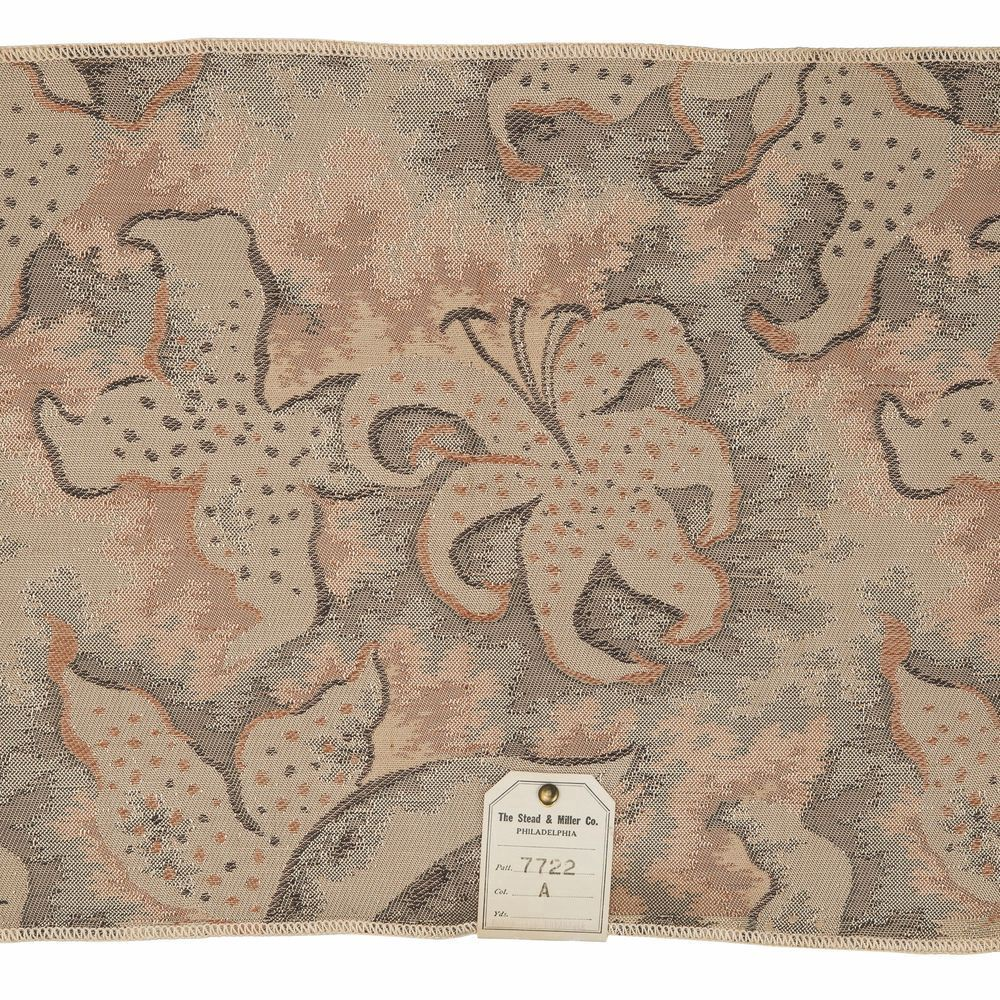 "A piece of sample fabric showing ""Lilies in the Air"" by Marguerita Mergentime."