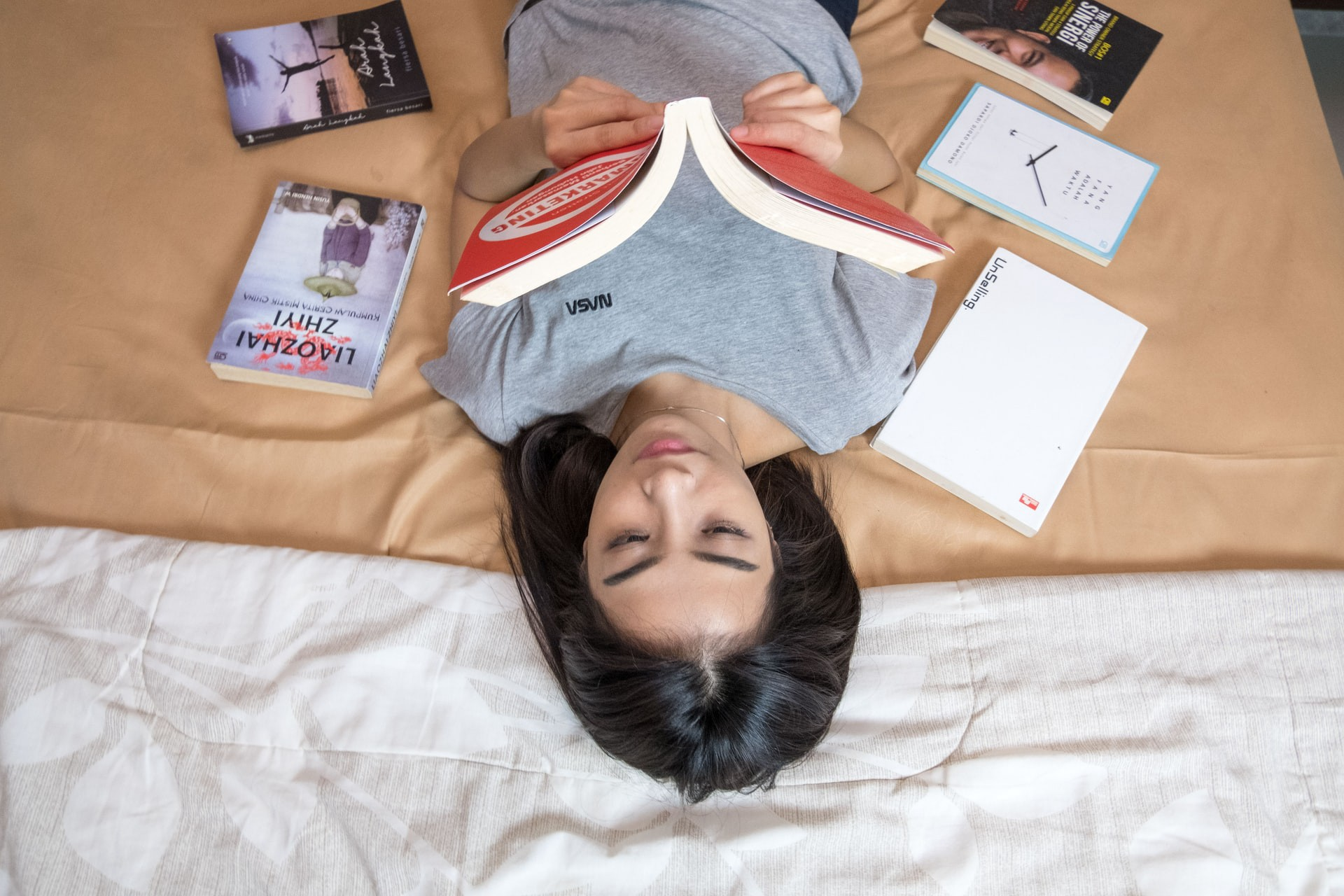 the joys of reading a book while lying down