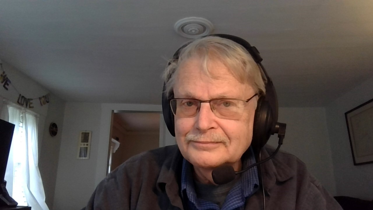 Image of counselor with headset.