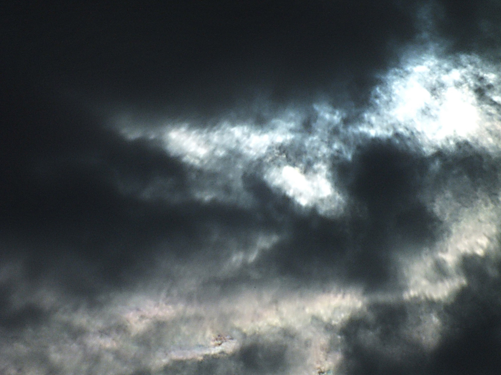 An angry sky fill of dark clouds and smoke.