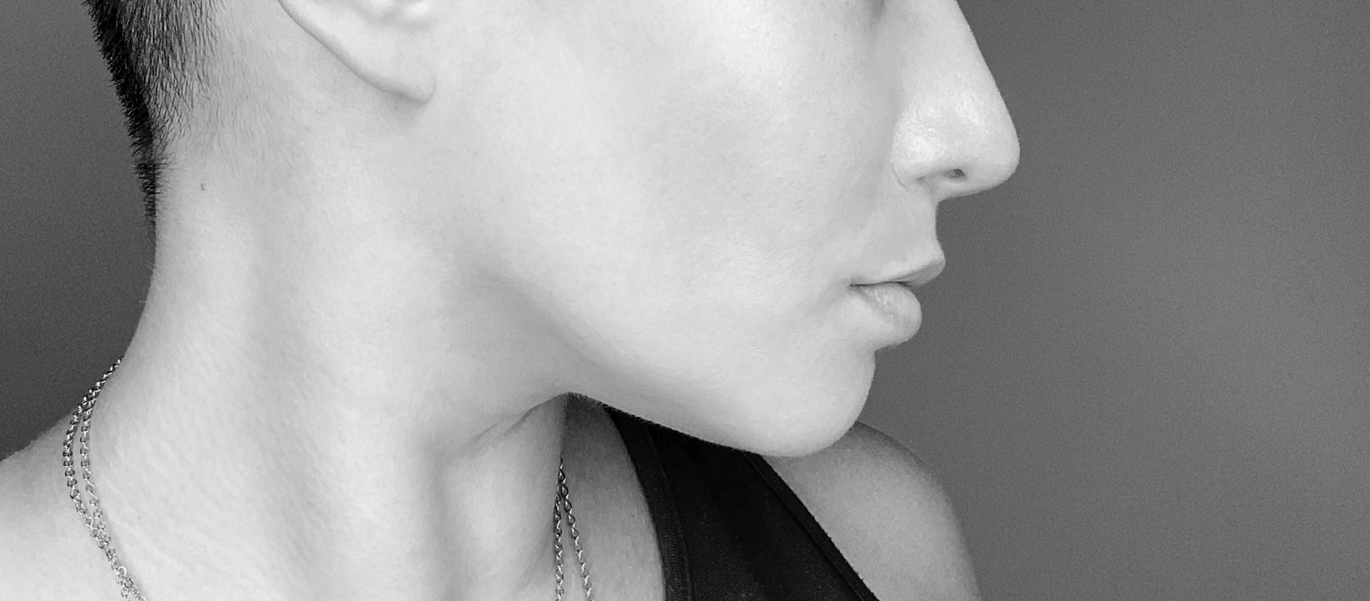 The profile of a woman's face from her collarbone to just below her eyes.