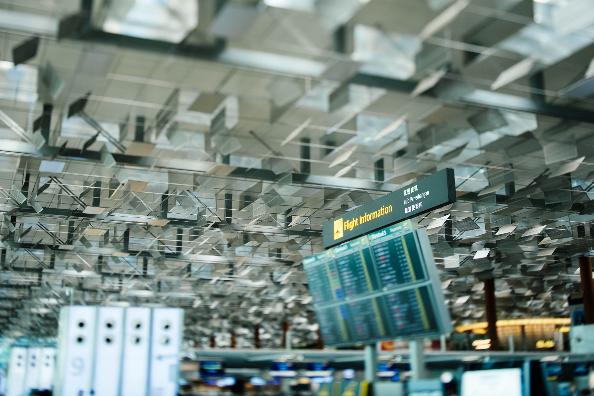 A visual display at an Airport terminal showing the Flight Arrival and Departure Information.
