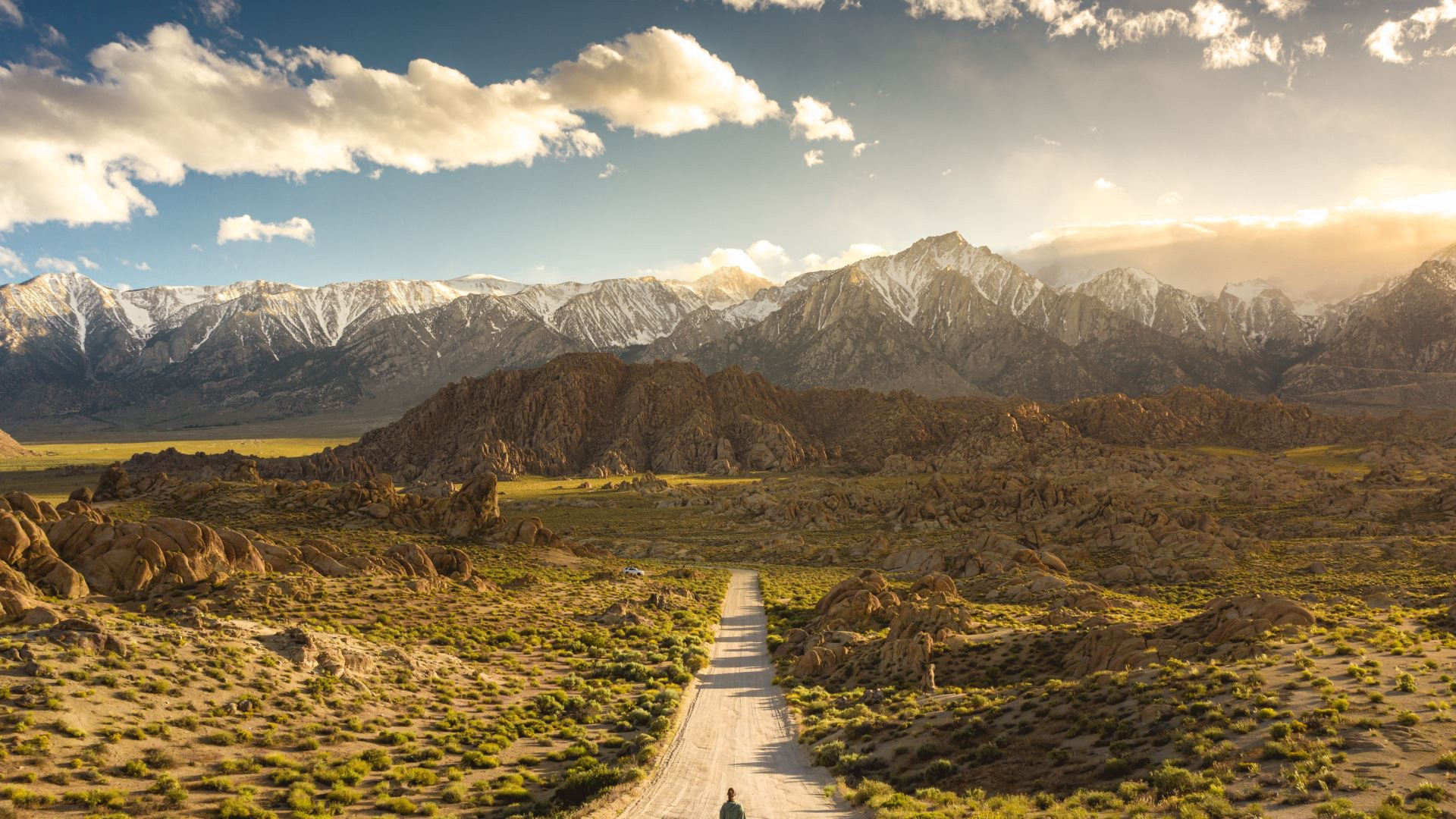 Lonely person walking on a pathway in alabama hills in california with mount whitney