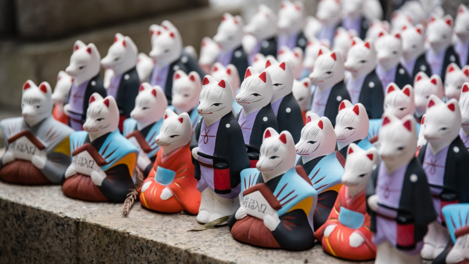 Image of fox shaped statues at a shrine in J
