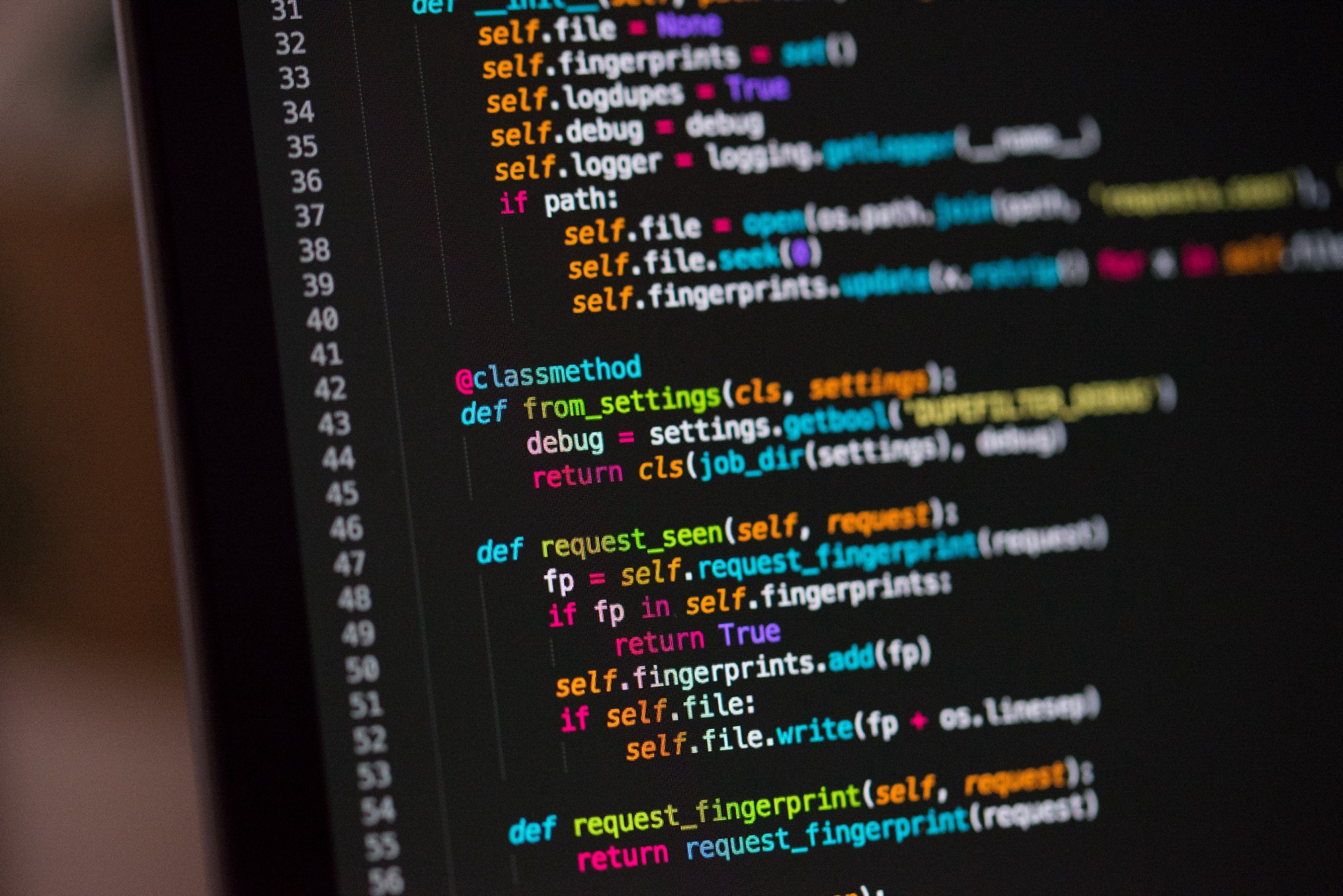 A photo of some Python code by Chris Ried on Unsplash