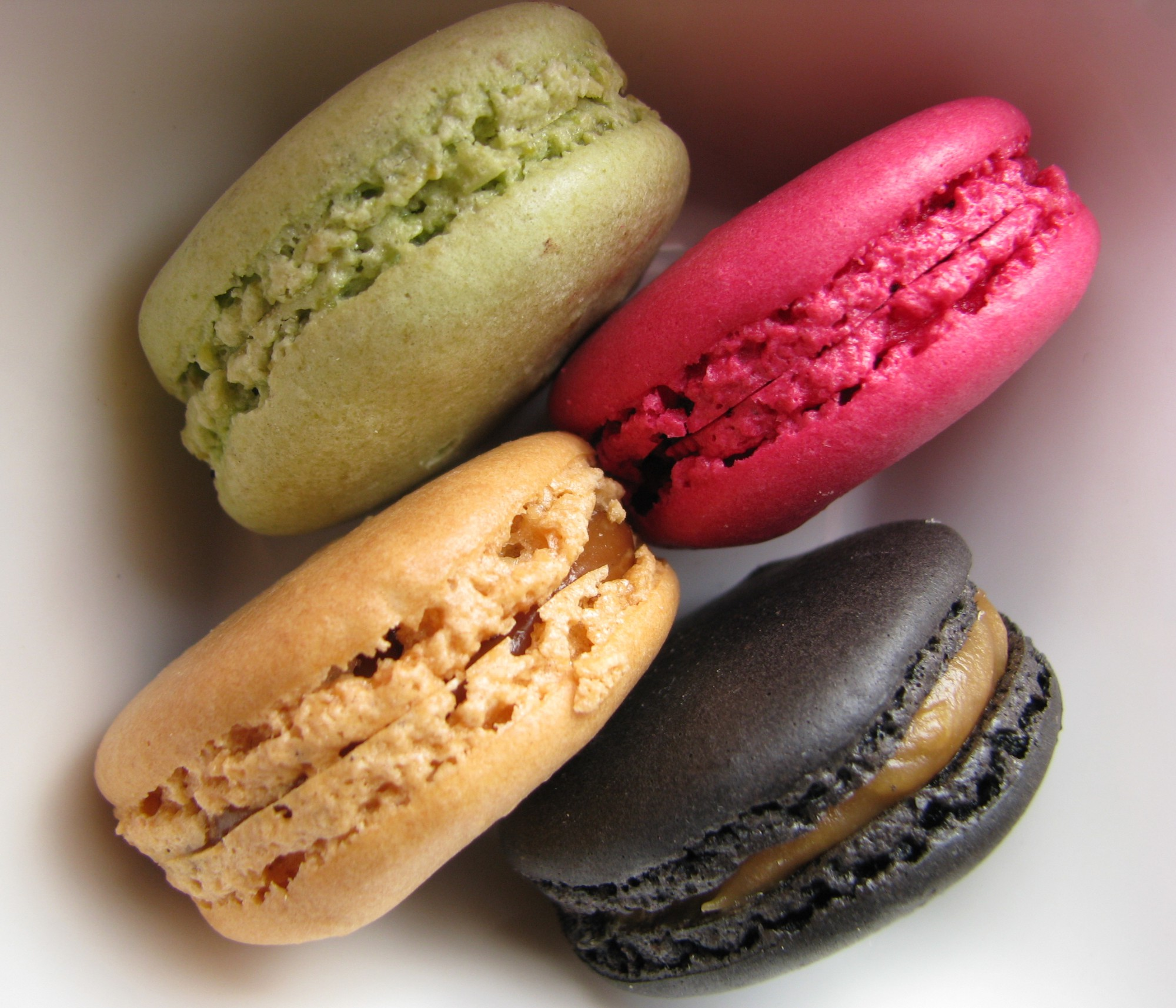 4 differently-colored macarons photographed up-close