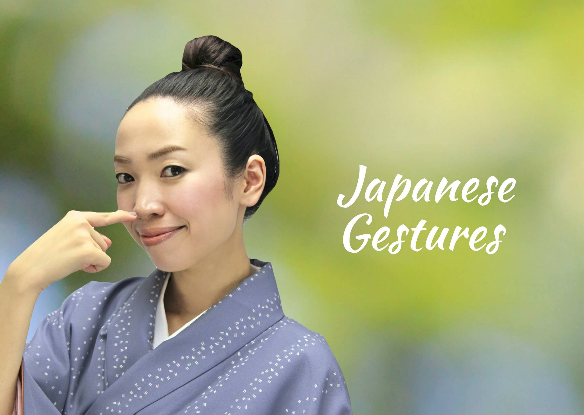 """Woman performing the Japanese gesture for """"me"""" in front of a blurred outdoor background."""