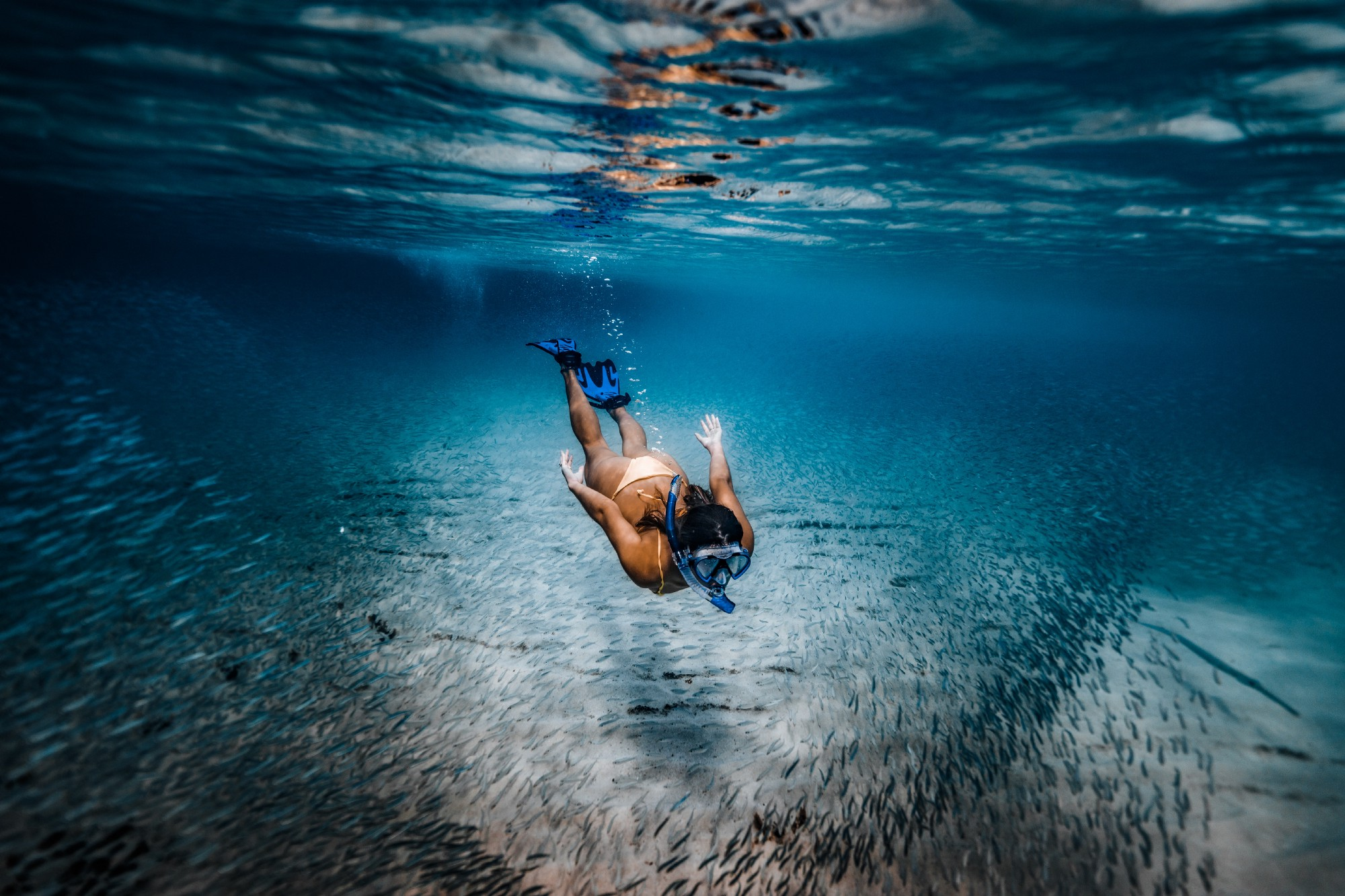 5 Golden Rules of Becoming Better Every Day — girl snorkelling in blue seas