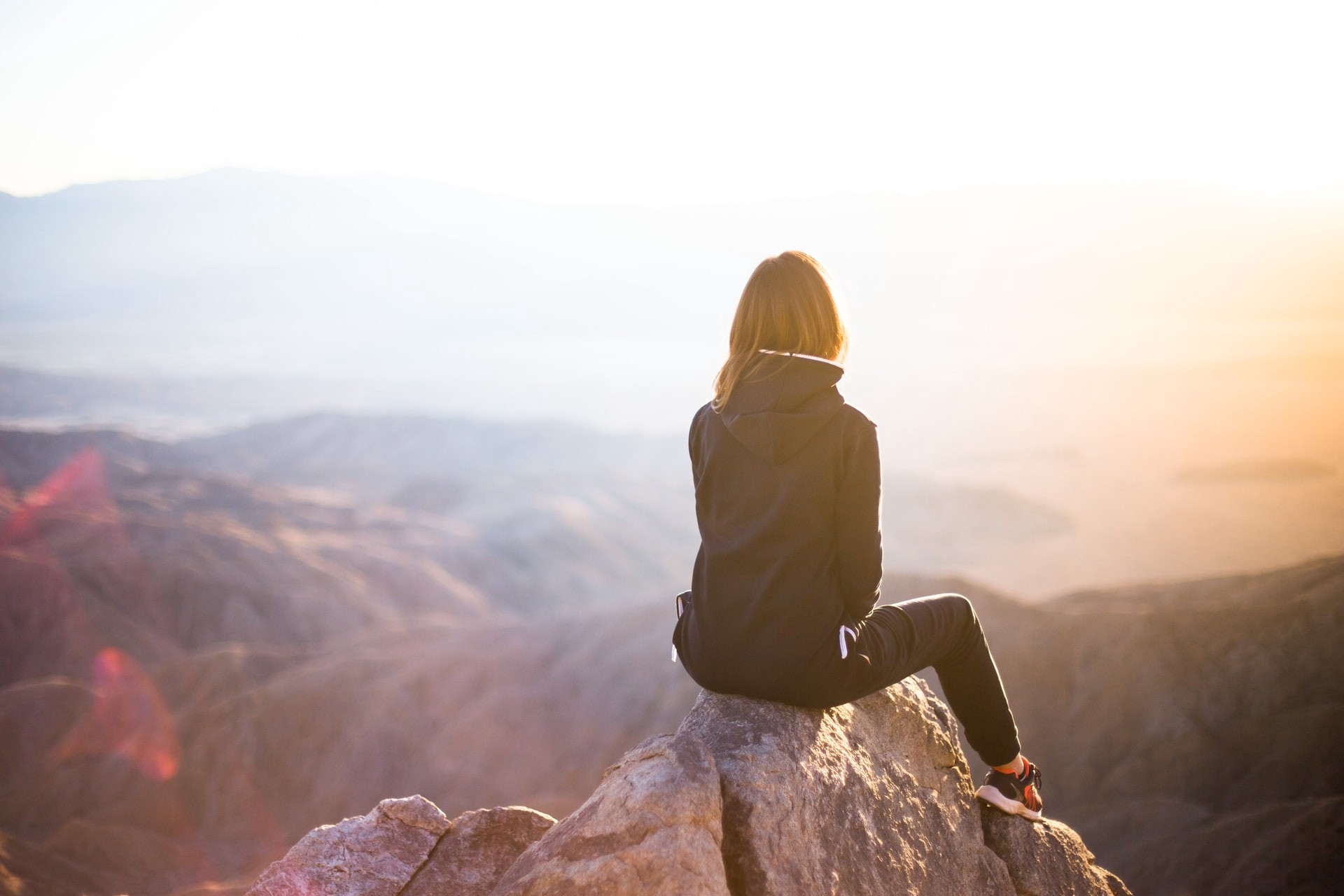 Woman on a top of a mountain looking at the view