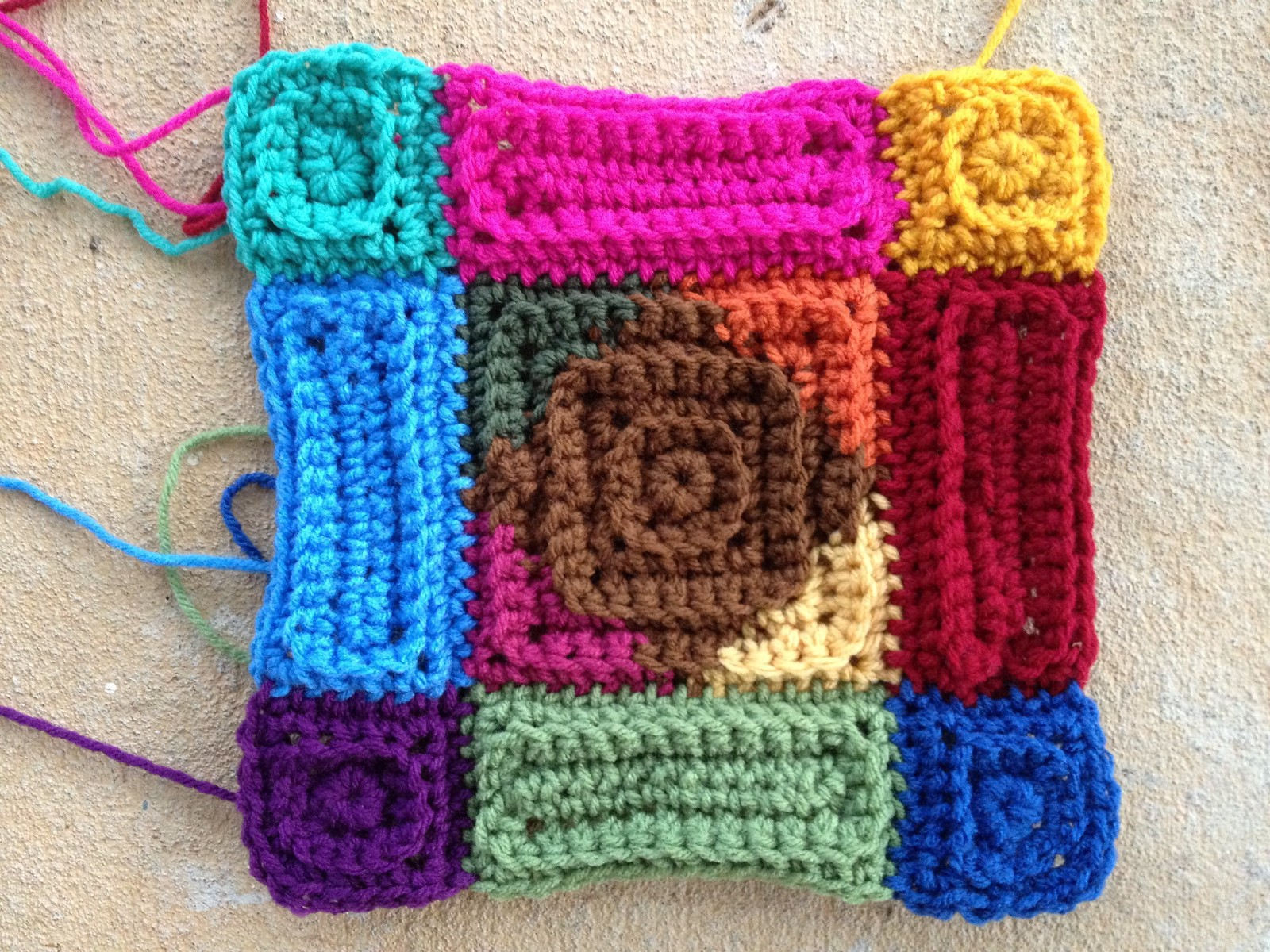 A multicolor textured square crochet motif composed of crochet squares and rectangles