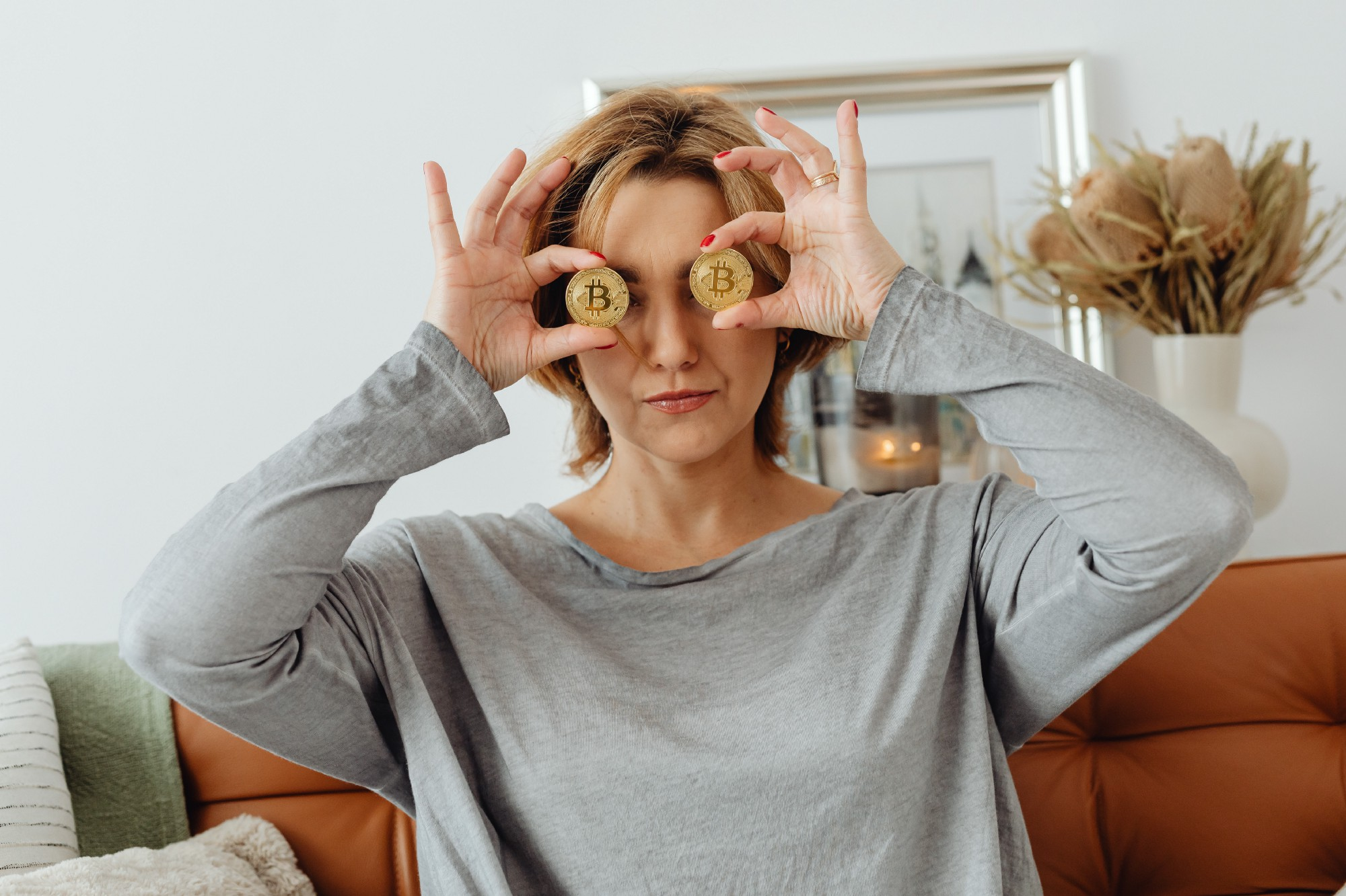 Woman holds a cryptocurrency Bitcoin