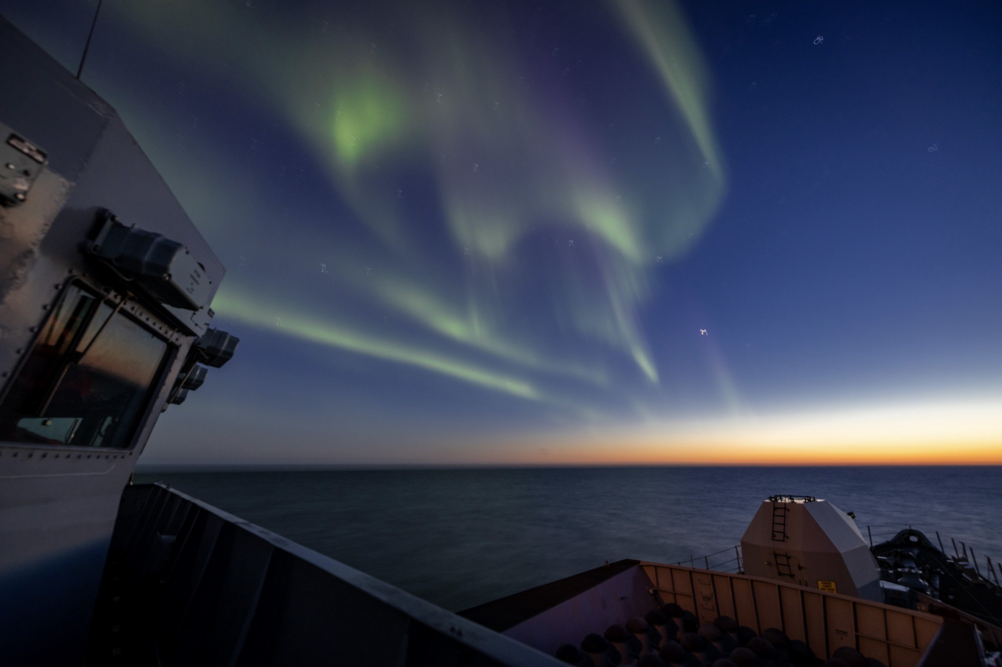 HMS Lancaster takes in the stunning lights display in the Arctic.