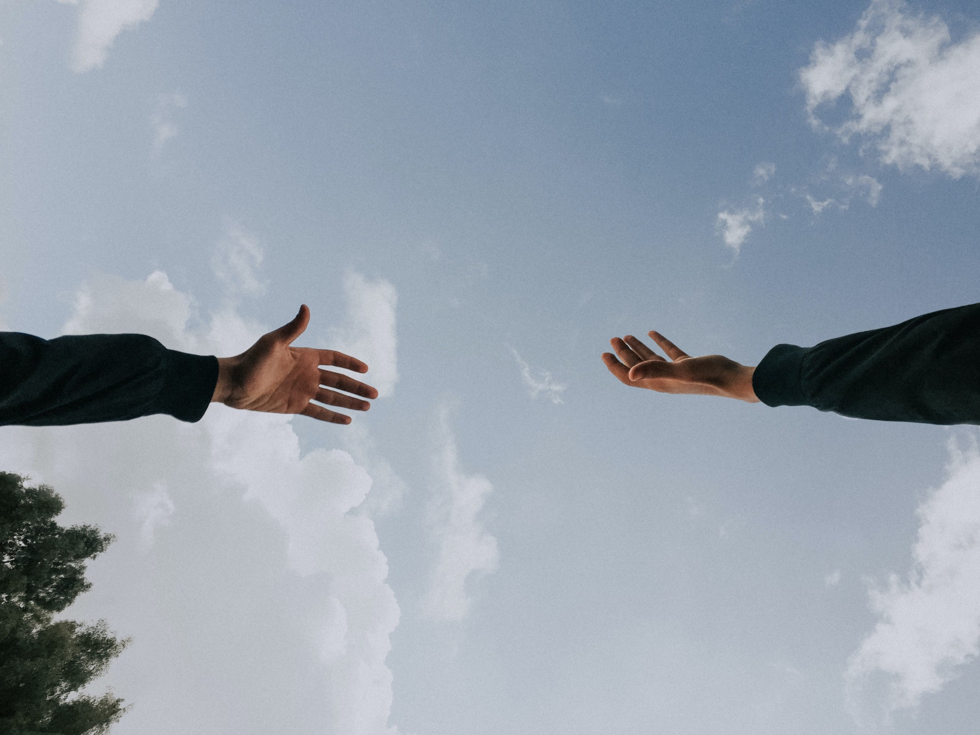 Two hands reaching out to help each other