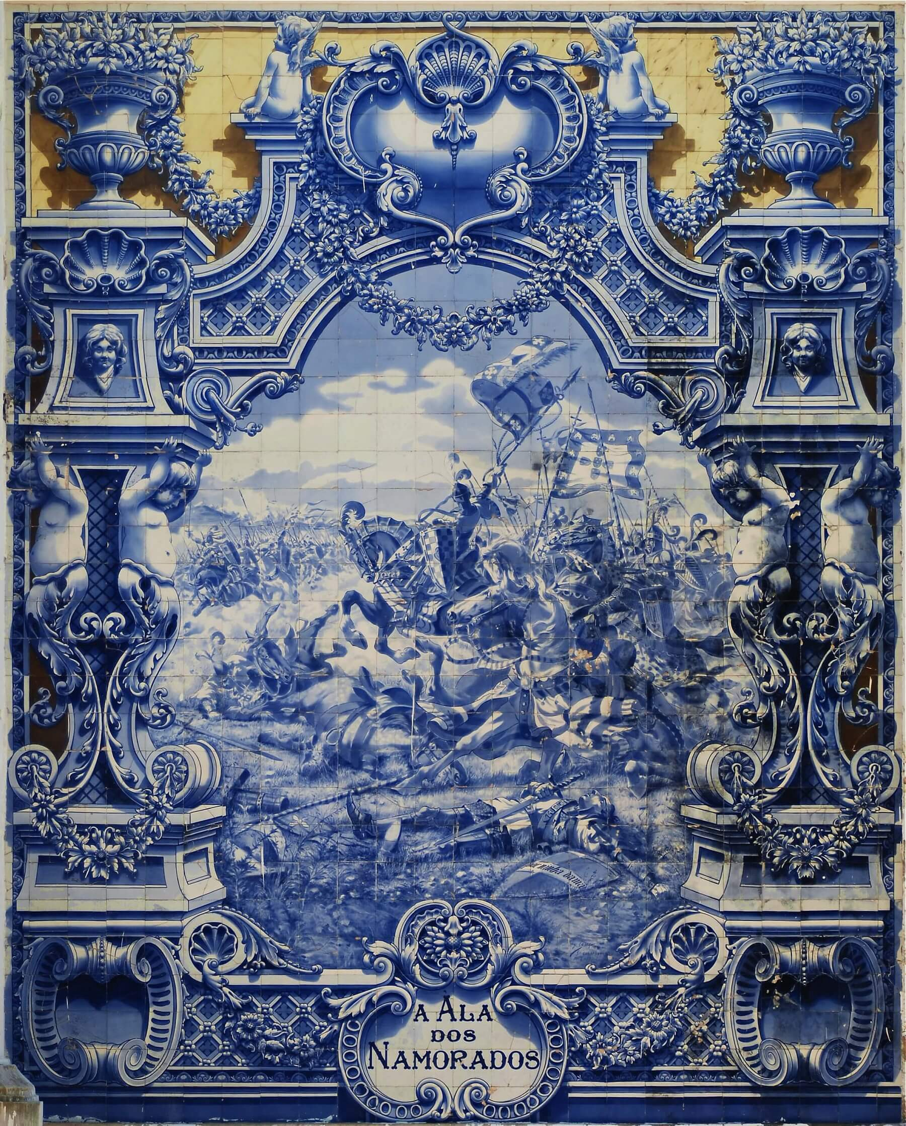 A panel of blue glazed tiles depicting a battle and a clouded sky in the background.