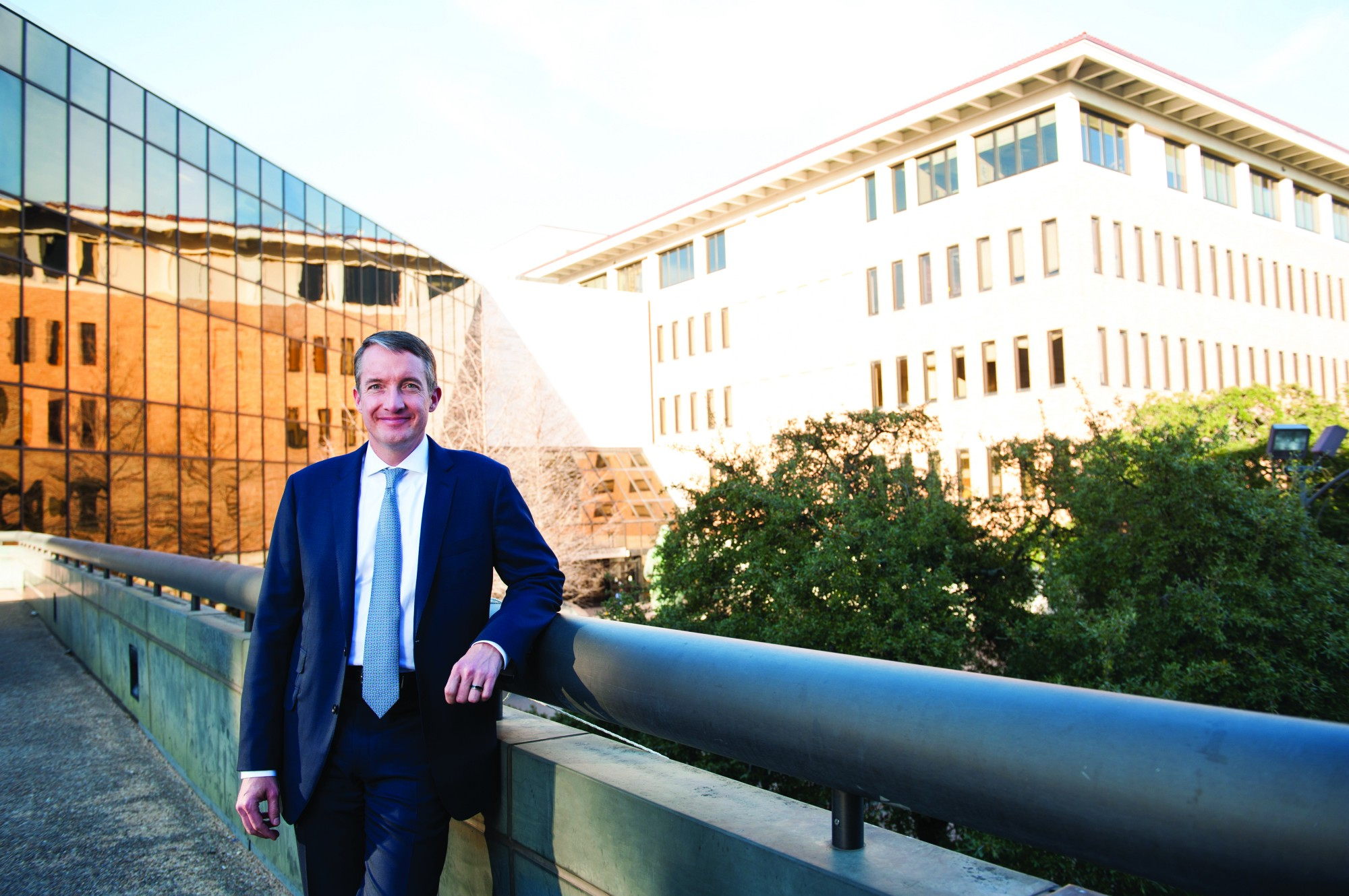 Jay Hartzell stands in front of the McCombs School of Business
