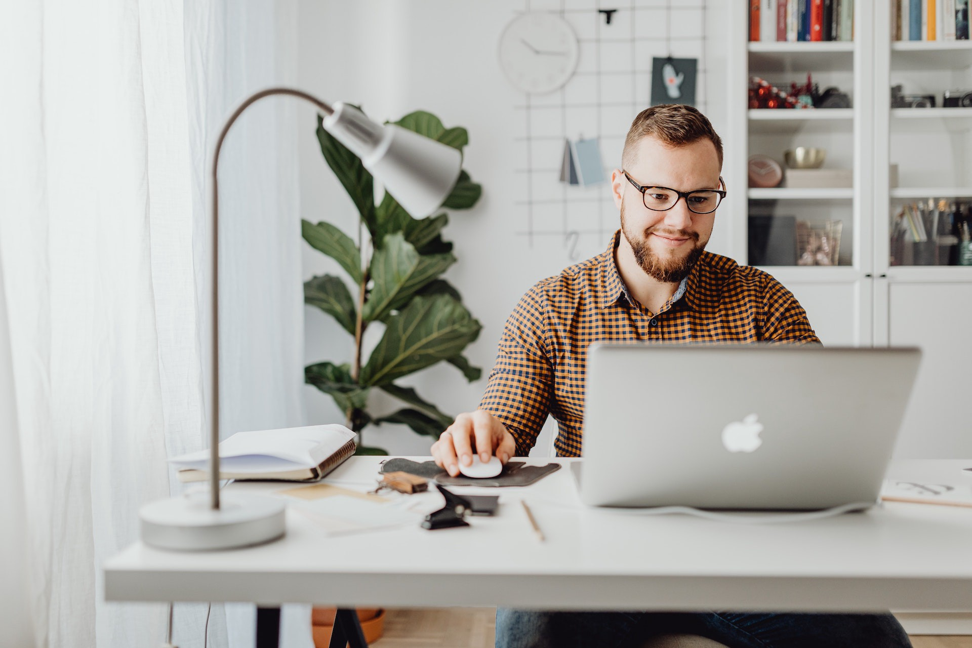 Man working at a desk.