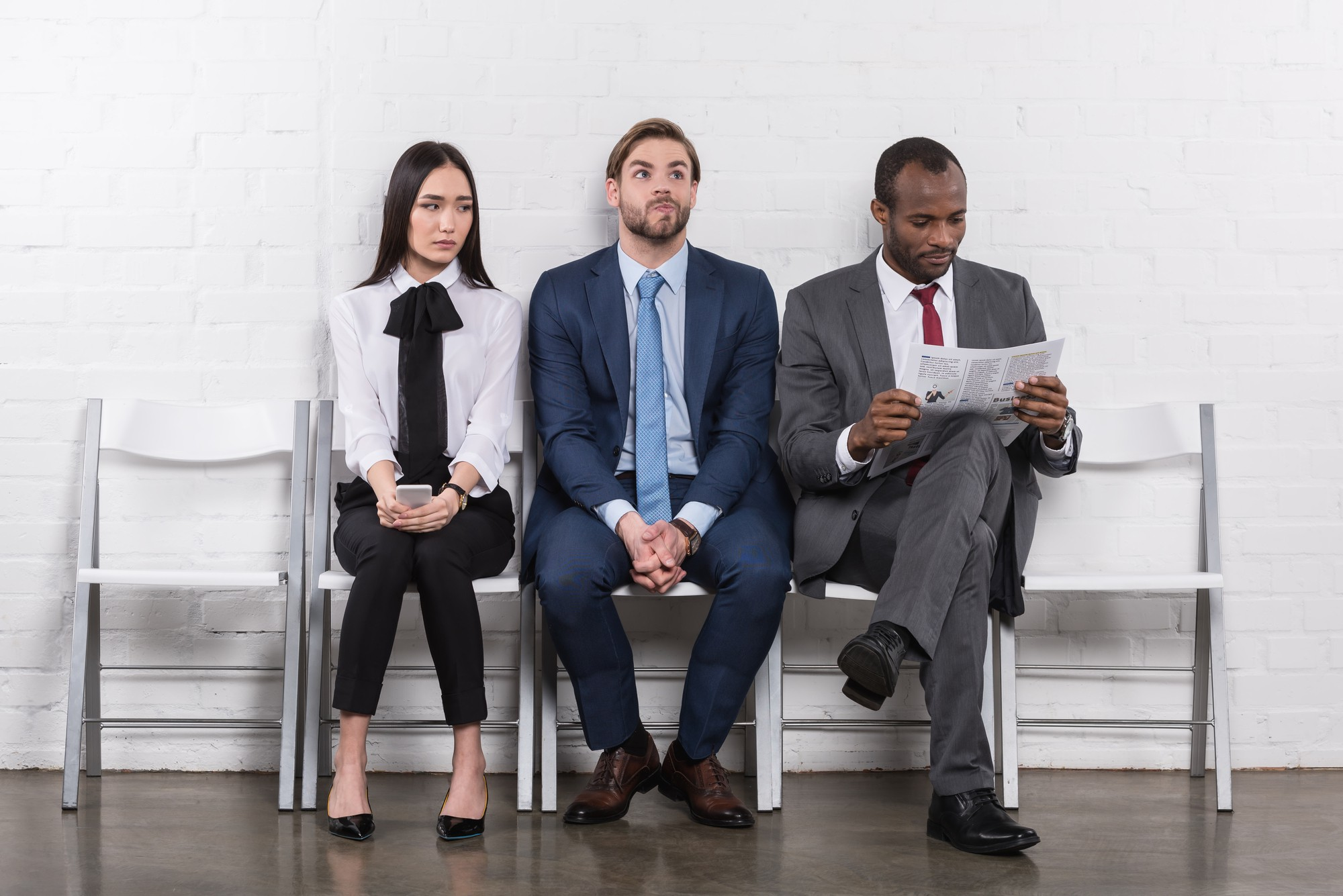 Source: https://depositphotos.com/184229582/stock-photo-multiethnic-young-business-people-waiting.html