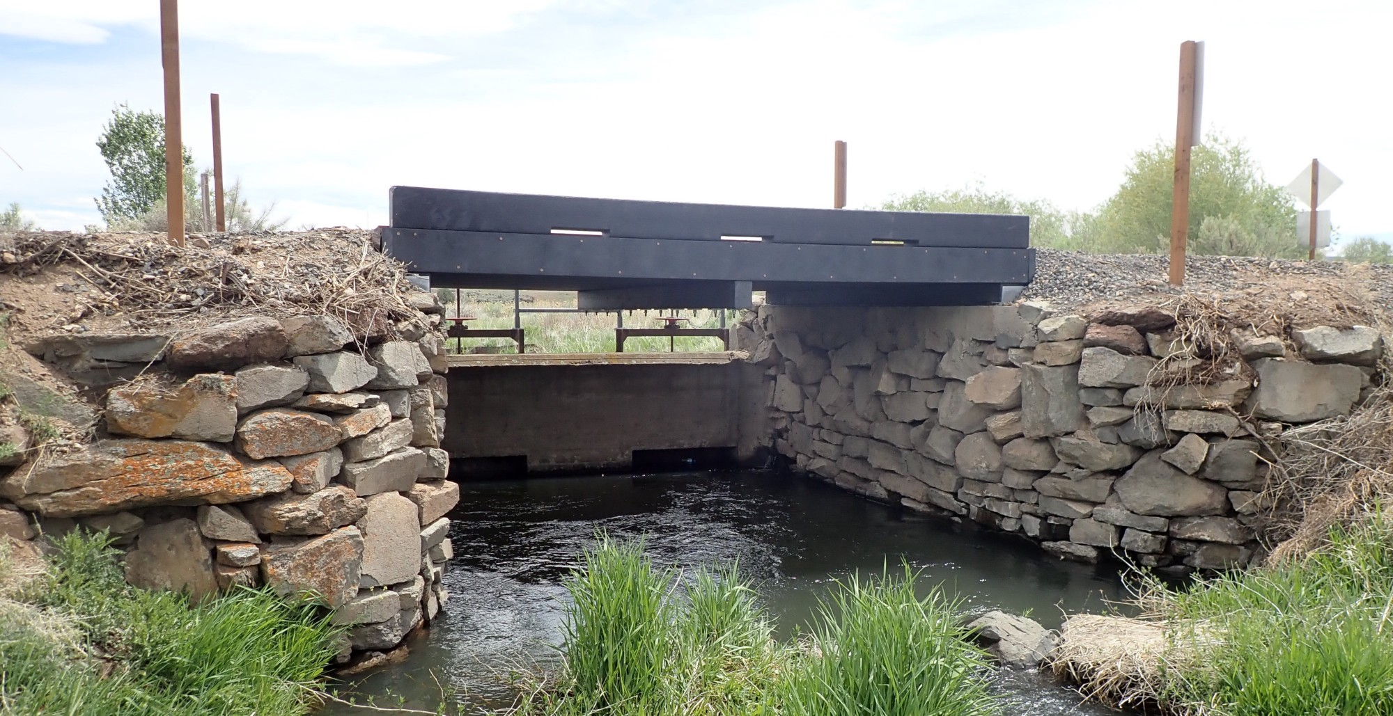 The 16-foot thermoplastic structure carries vehicle and foot traffic across Bridge Creek on East Canal Road. The span is made from 100% post-consumer and industrial recycled plastic.