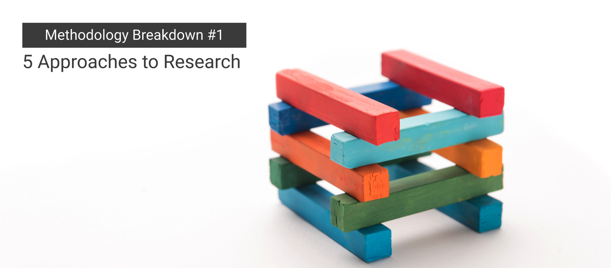 An image of bricks laid on top of each other. Text: Methodology Breakdown #1 - Approaches to Research