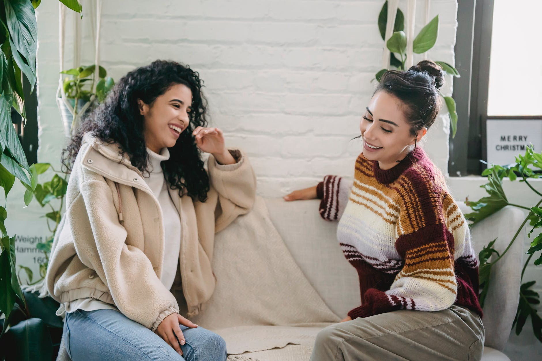 Happy women talking on a couch and being perfect listeners