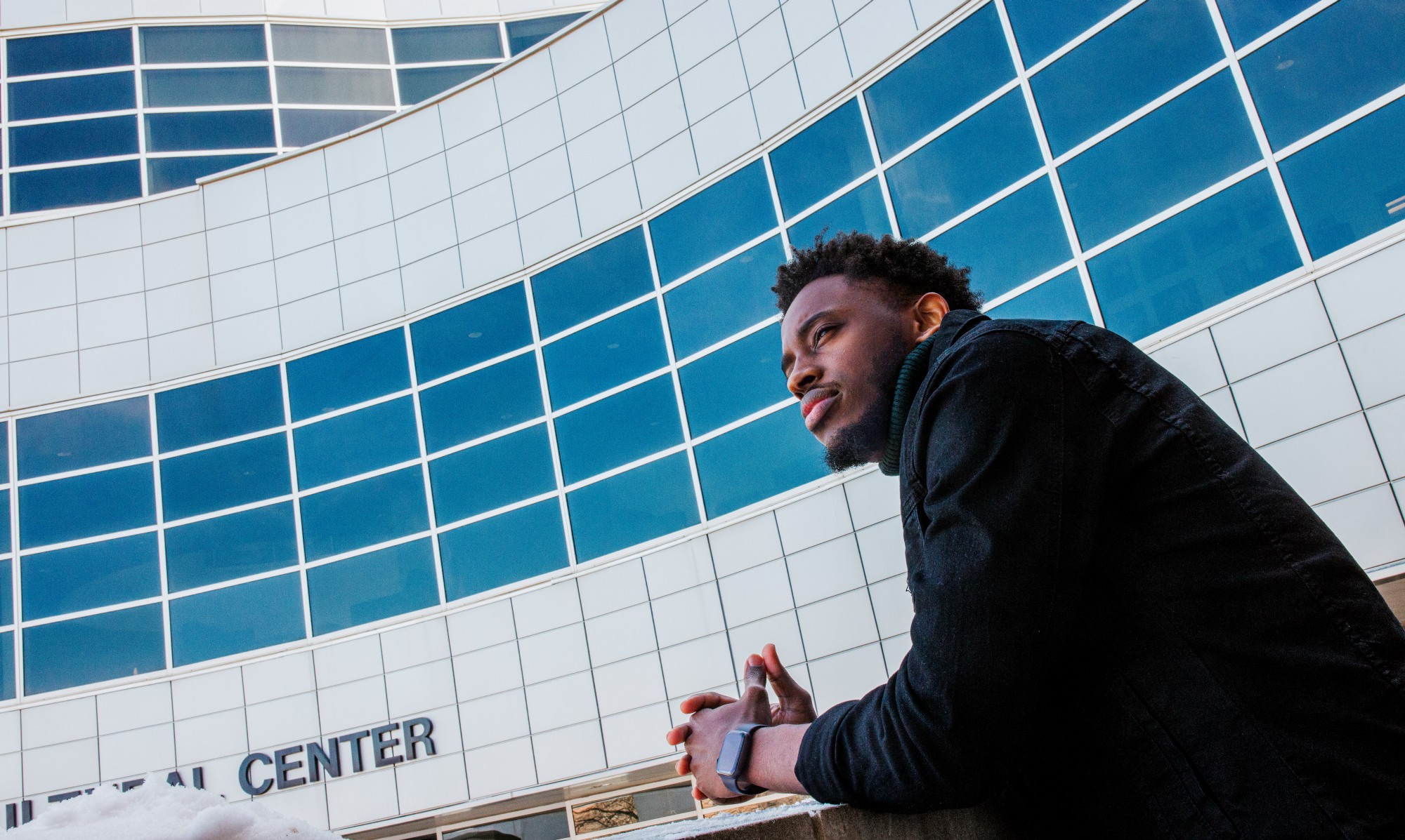 Damien poses outside the Jackie Gaughan Multicultural Center as he looks to the left