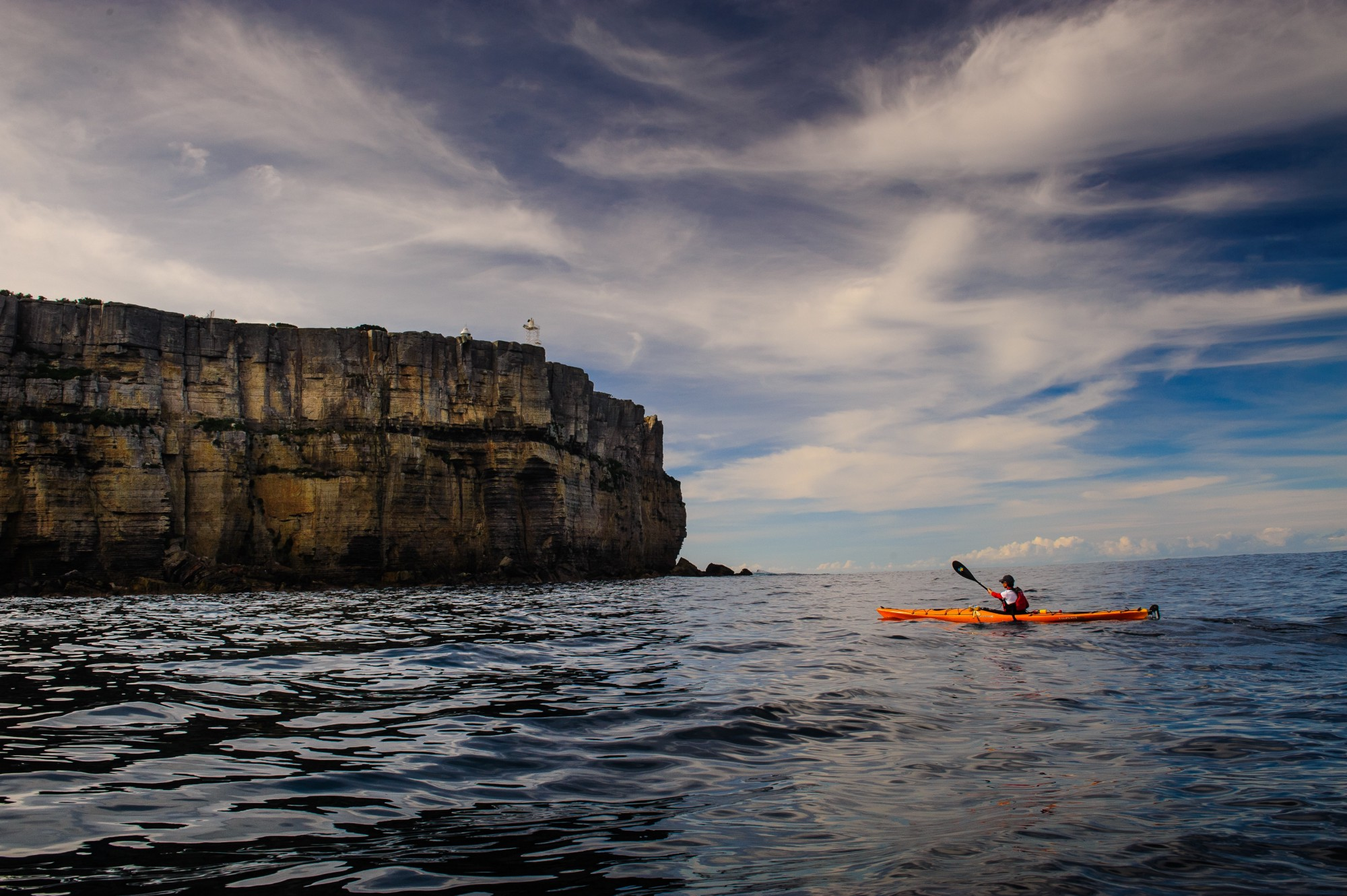 A kayaker in the ocean.