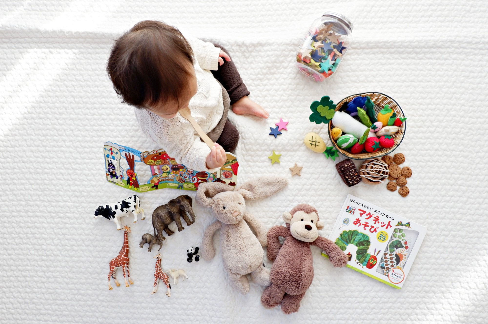 Child surrounded by toys.