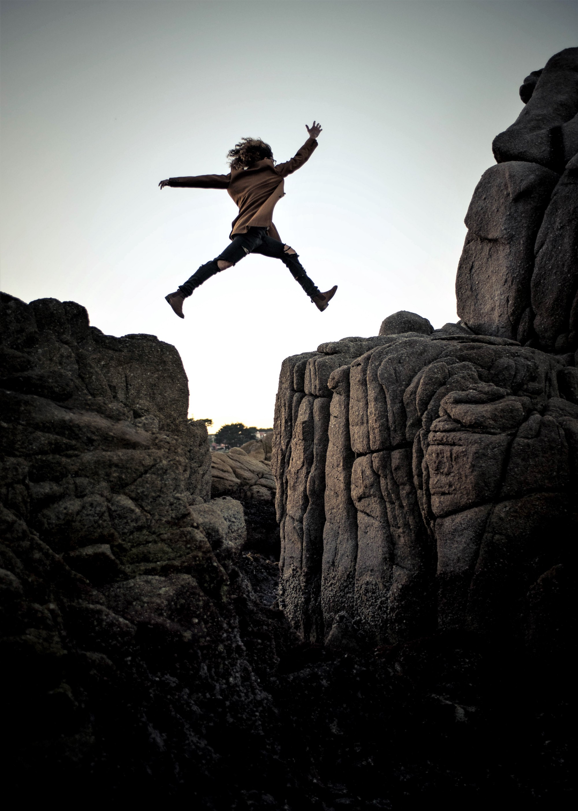 Person jumping over a chasm.