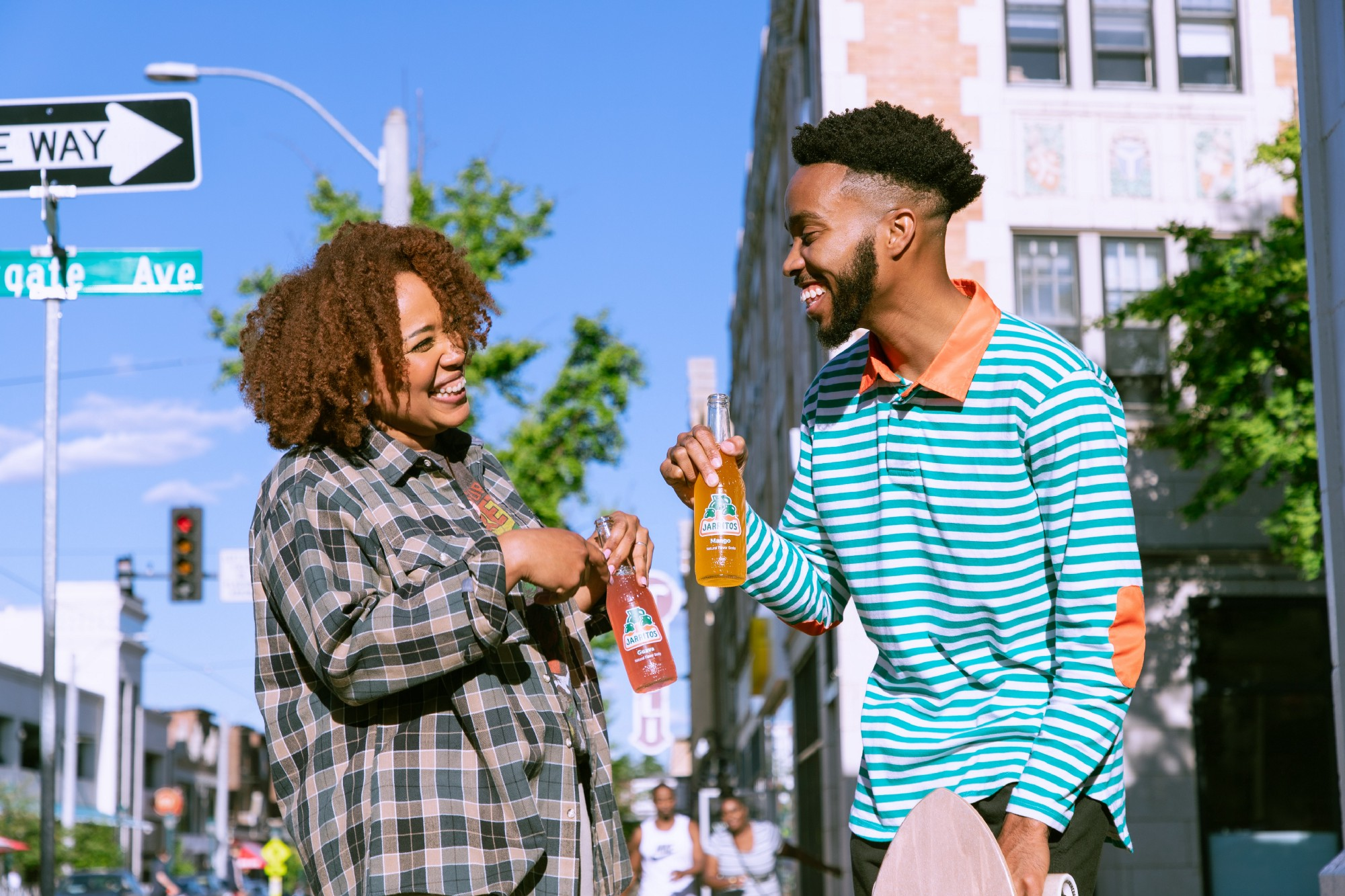 a man and a woman cheering on the street