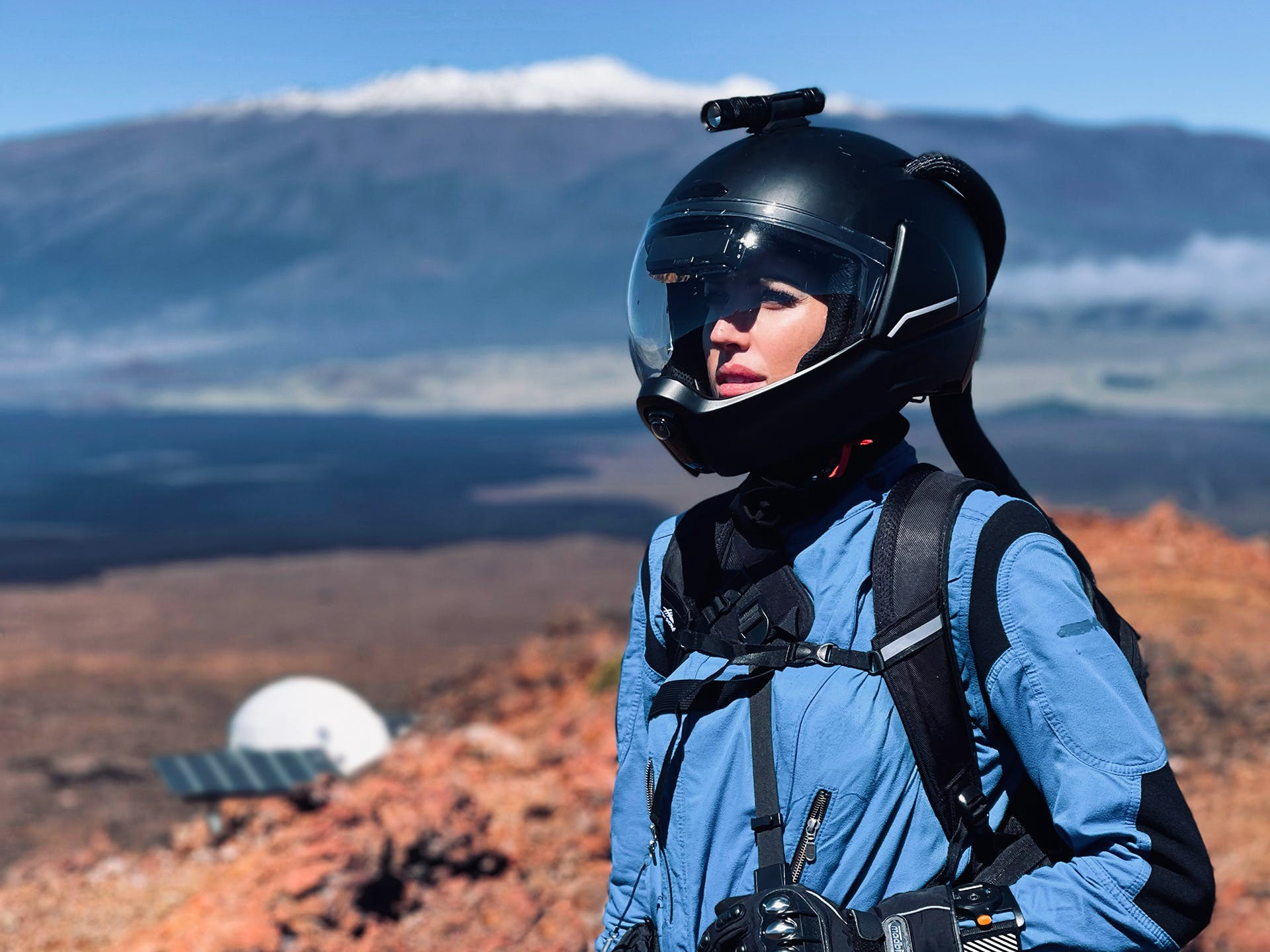 Hillary Coe dressed in a space suit for an analog Mars mission
