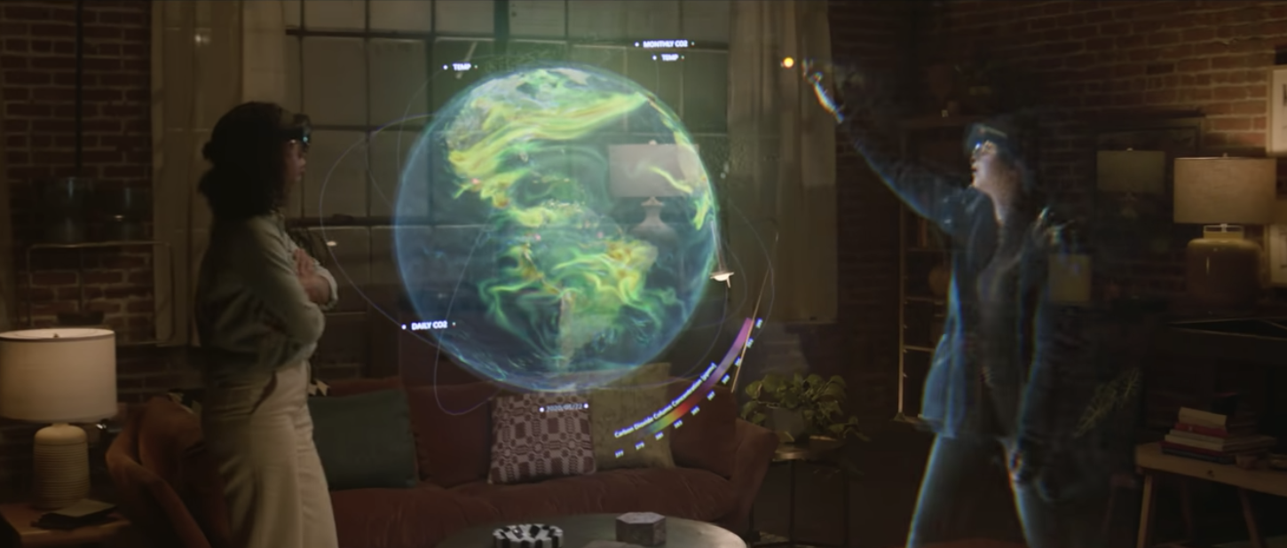 Two women in Hololens visors standing around a floating holographic earth as one interacts with the hologram.