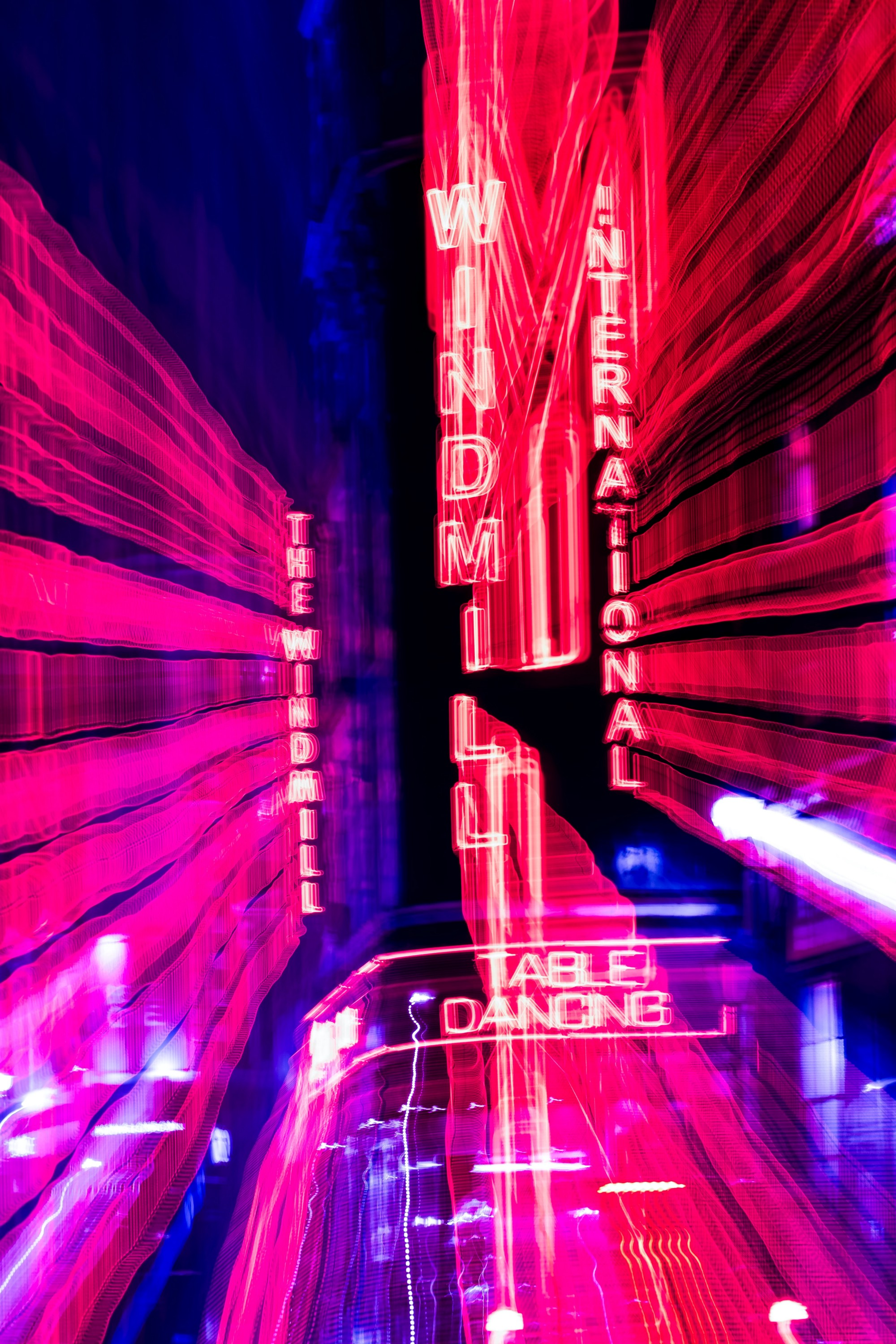 street illuminated by crazy neon lights