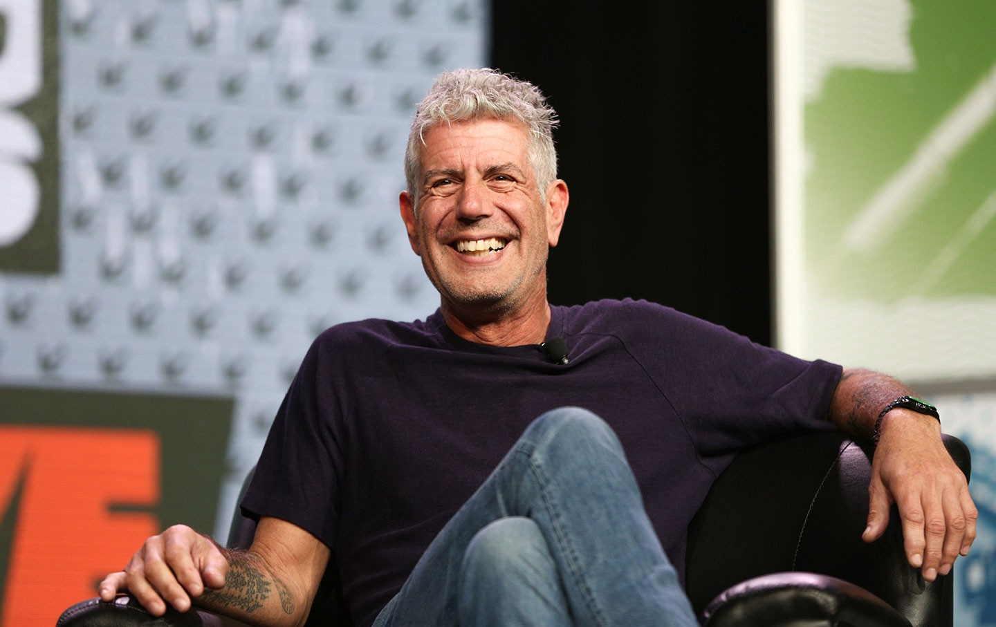 Anthony Bourdain sitting on stage at South by Southwest 2016