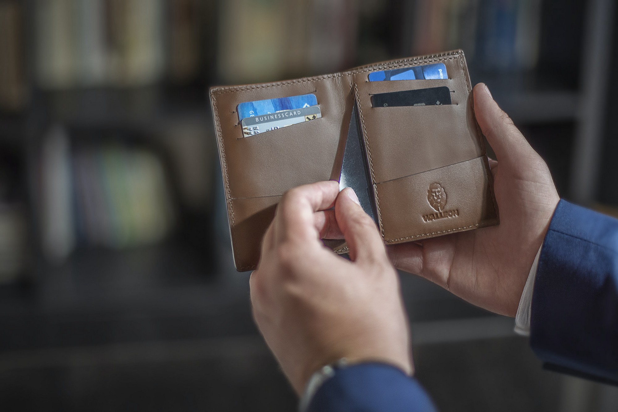 Card being inserted into a wallet.