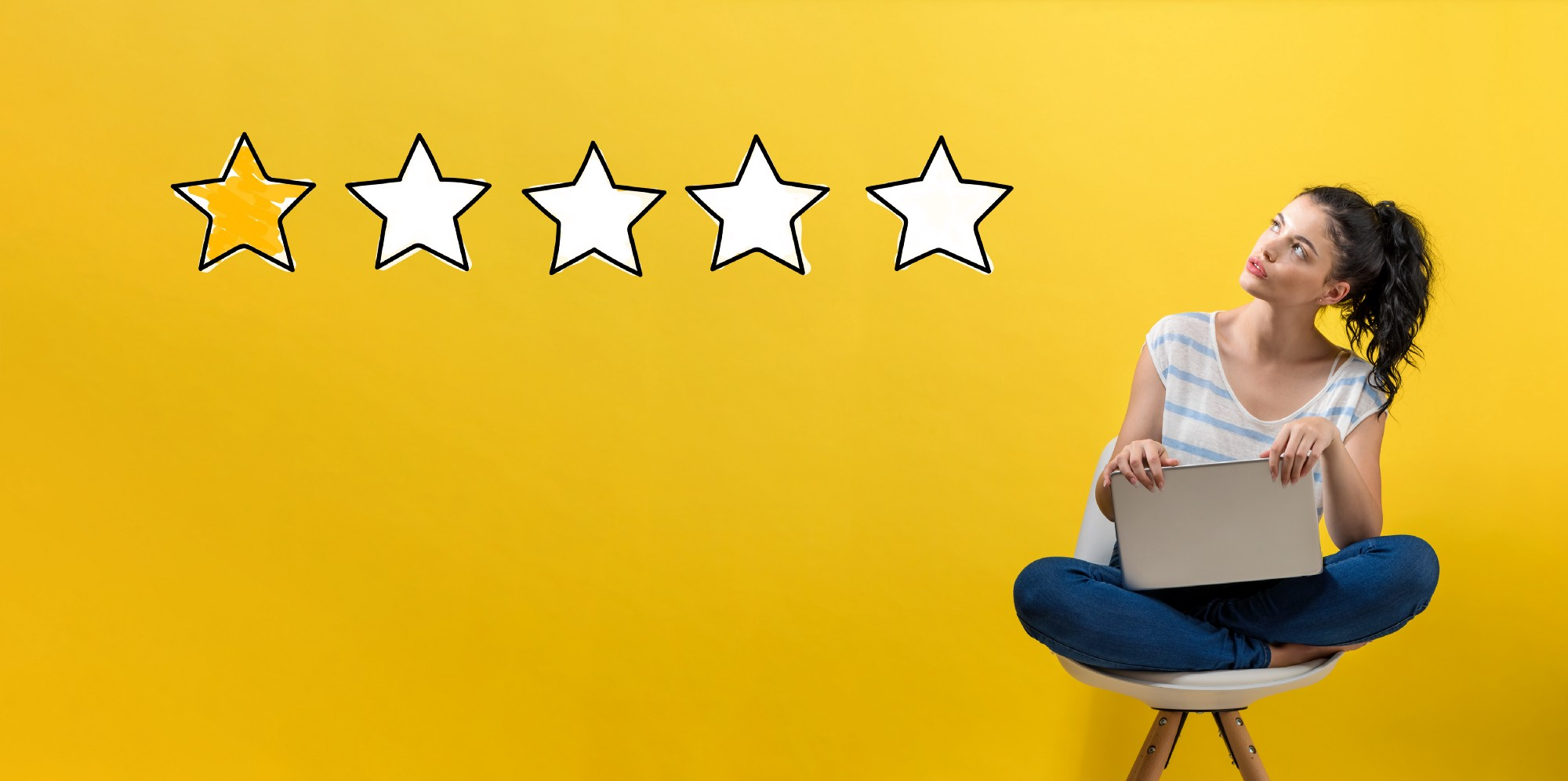 Image of woman shopping online leaving a 1-star negative customer review
