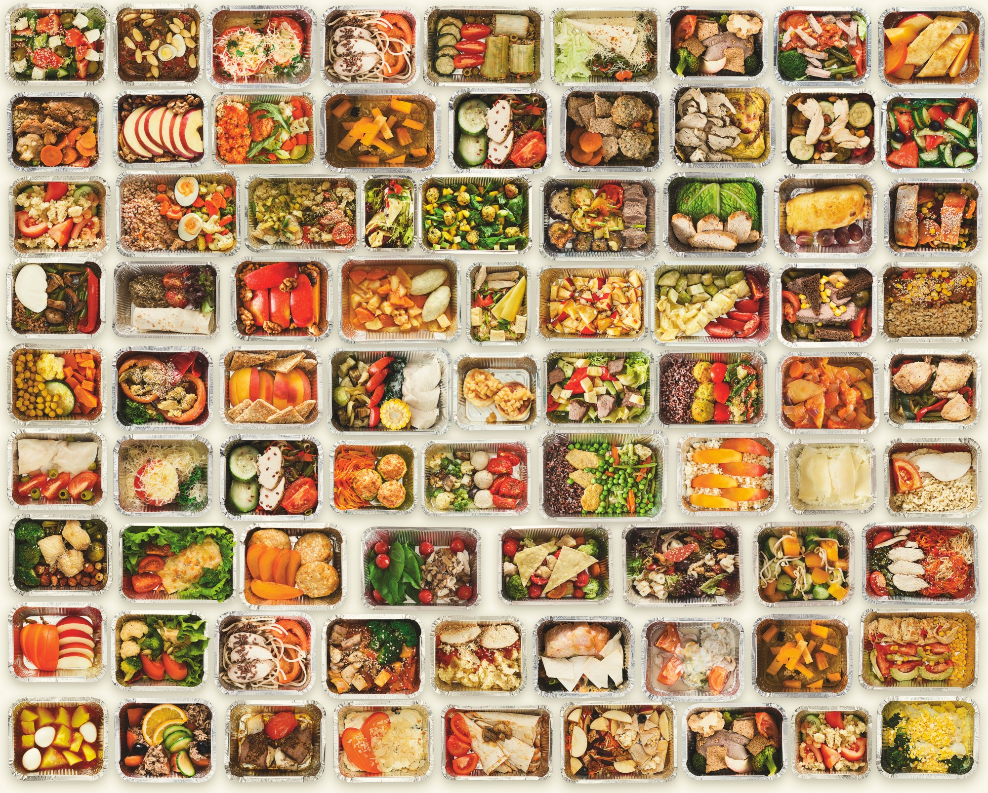 A set of a variety of healthy foods in take away food boxes against a white background.